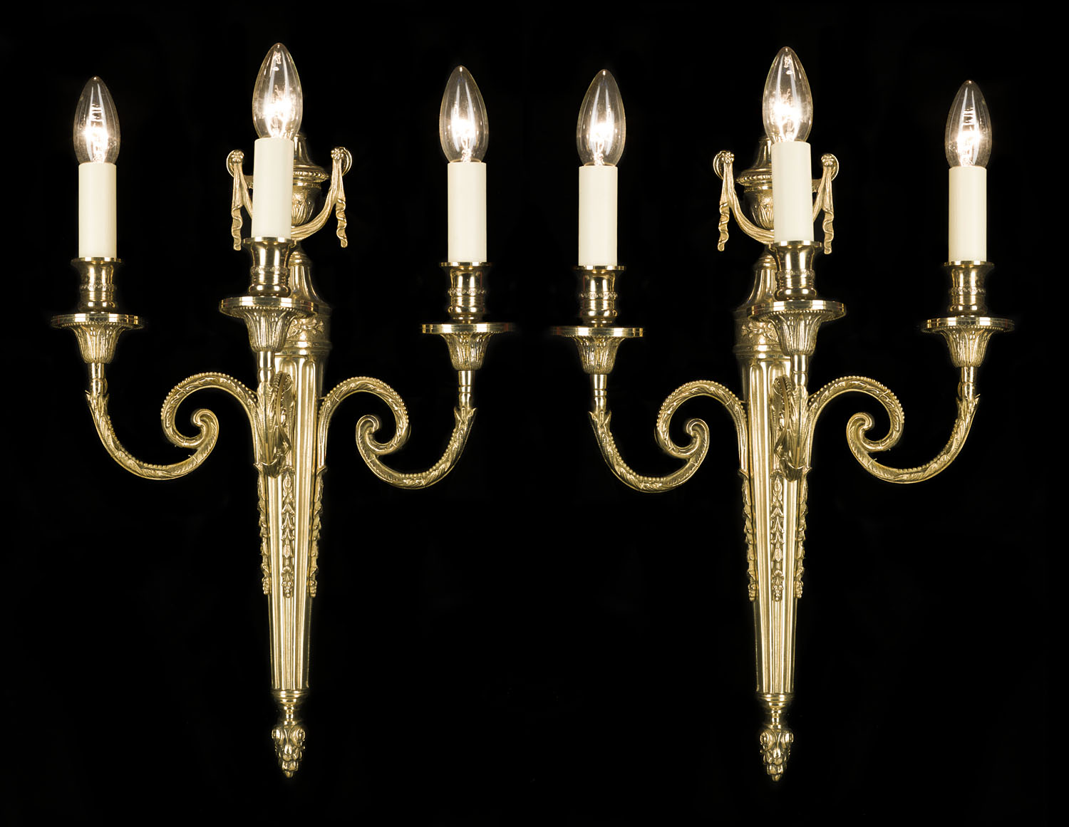 A pair of 20th century Georgian style brass wall lights