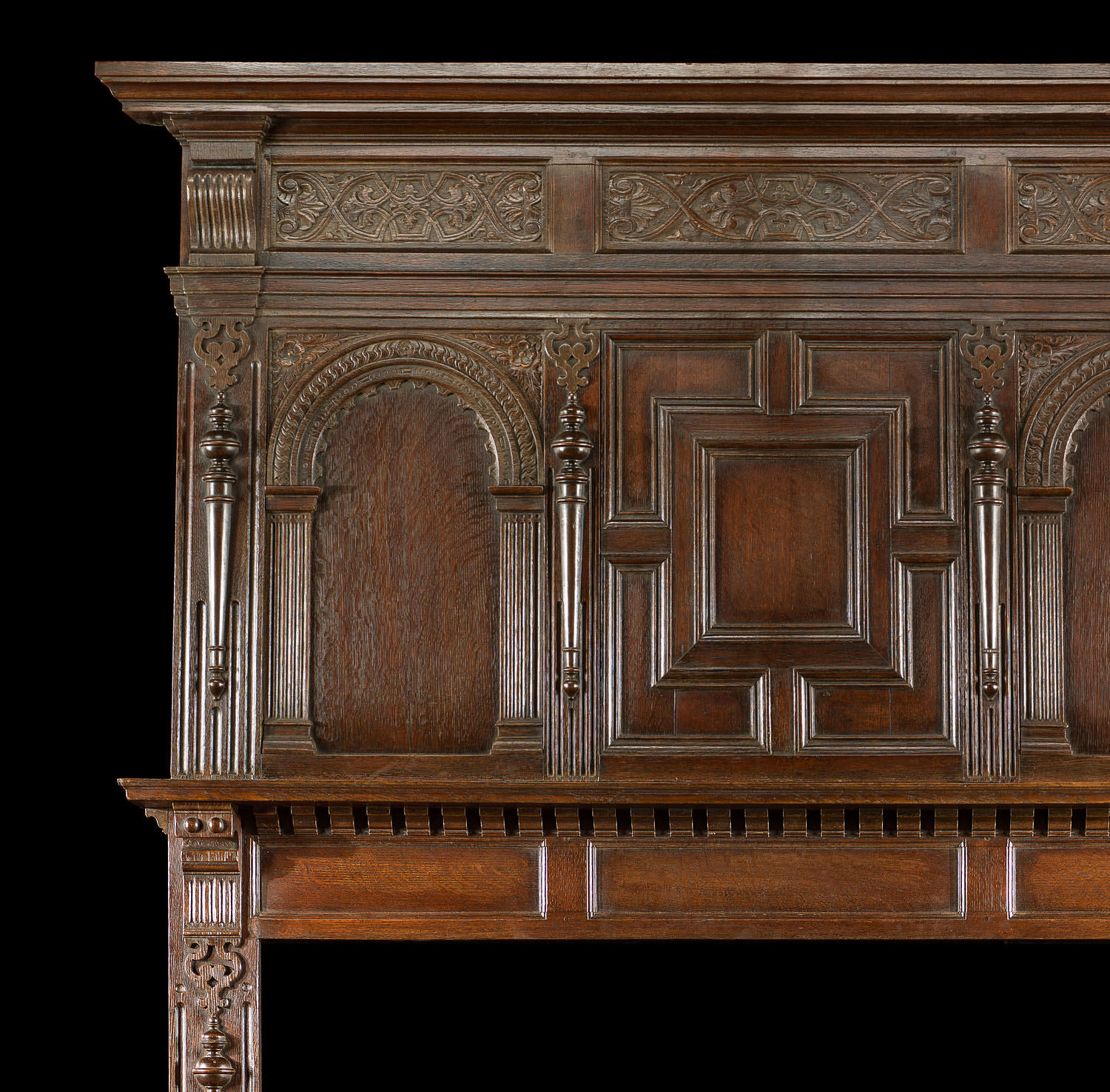 A 19th century carved oak Jacobean style Fireplace Mantel