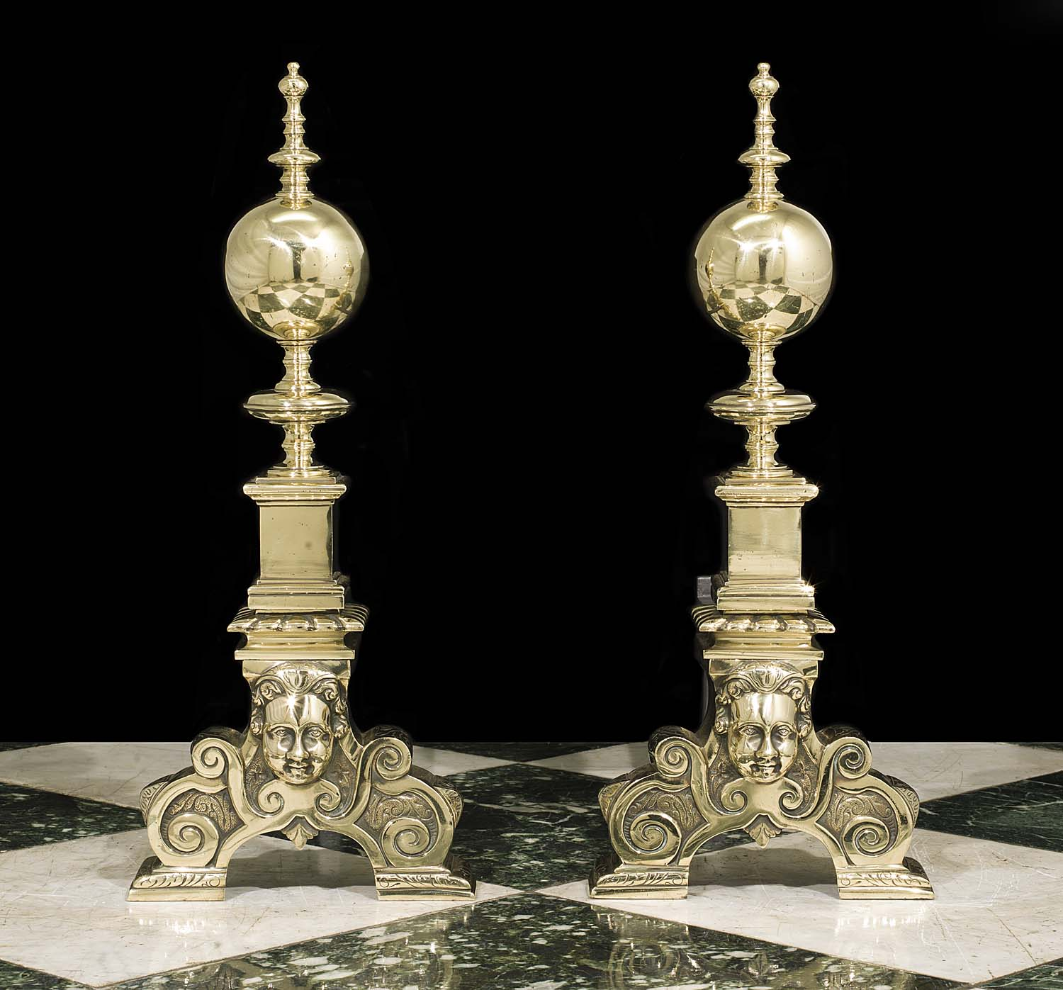 A tall pair of antique brass andirons in the Baroque style