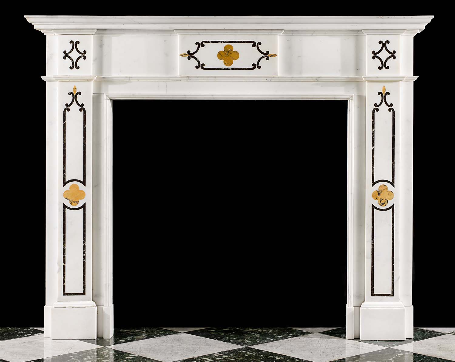 A Victorian marble inlaid fireplace in the Gothic Revival manner
