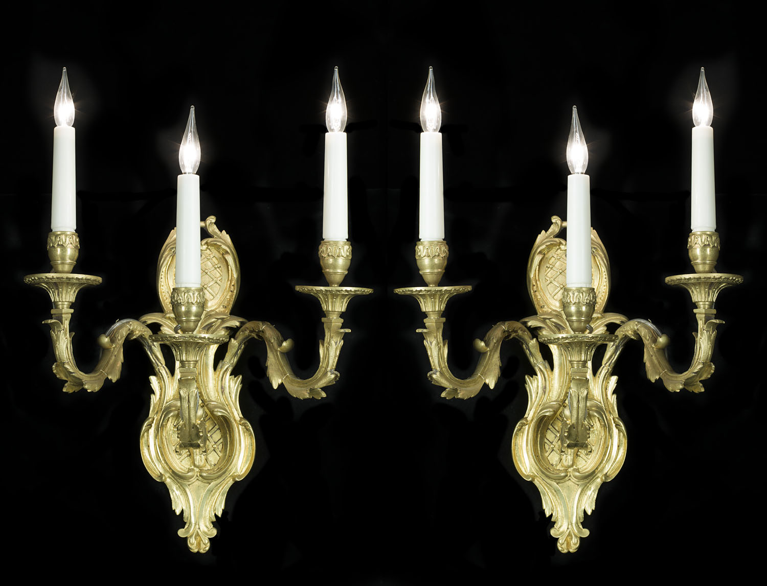 French 29th century three branch Baroque style wall lights