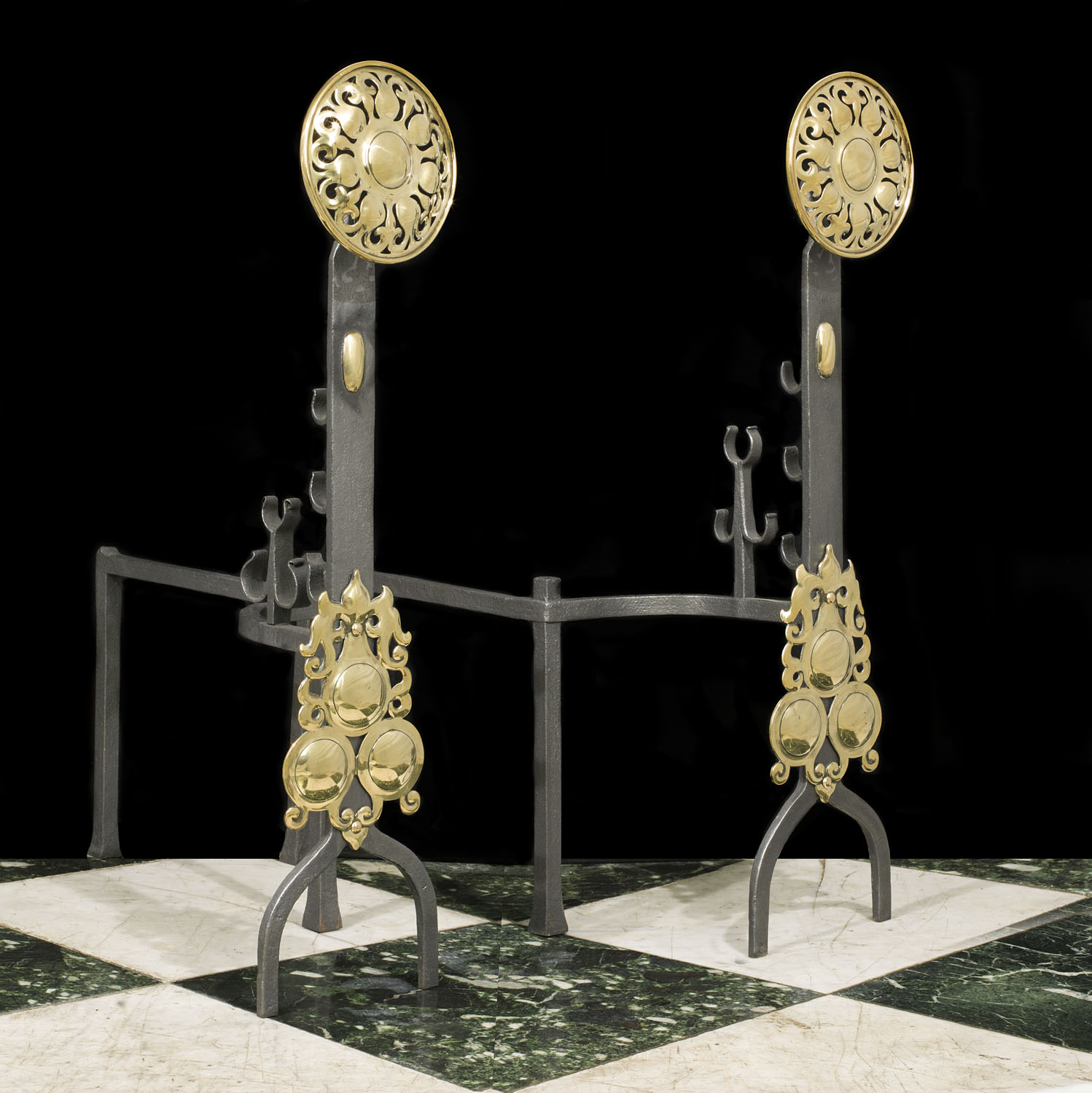 A pair of antique Arts & Crafts brass andirons