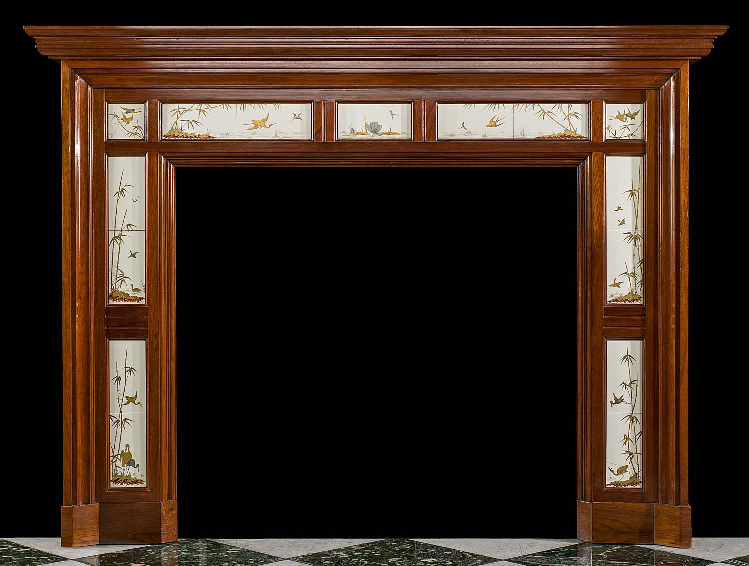 A Victorian antique chimneypiece in walnut set with rare Minton Tiles