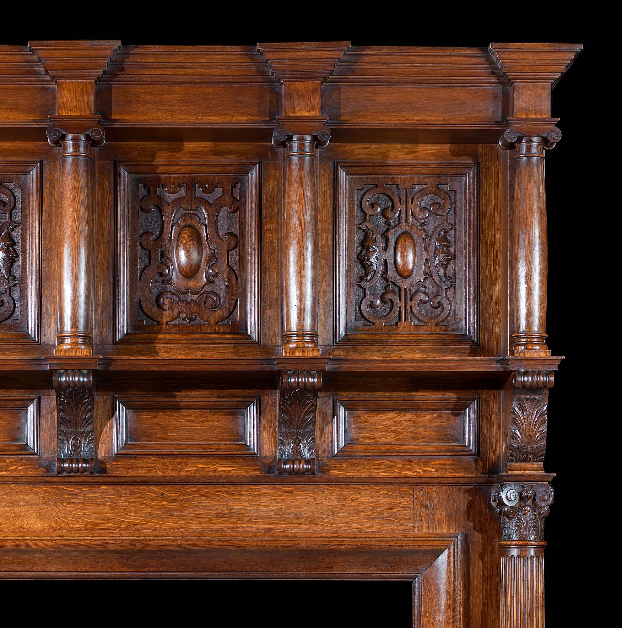 A Carved Oak Edwardian Chimneypiece and Overmantel