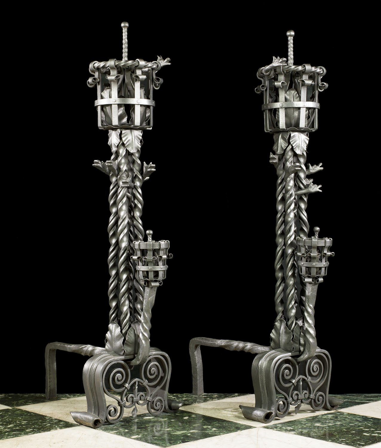 A pair of enormous Gothic Revival of antique wrought iron andirons