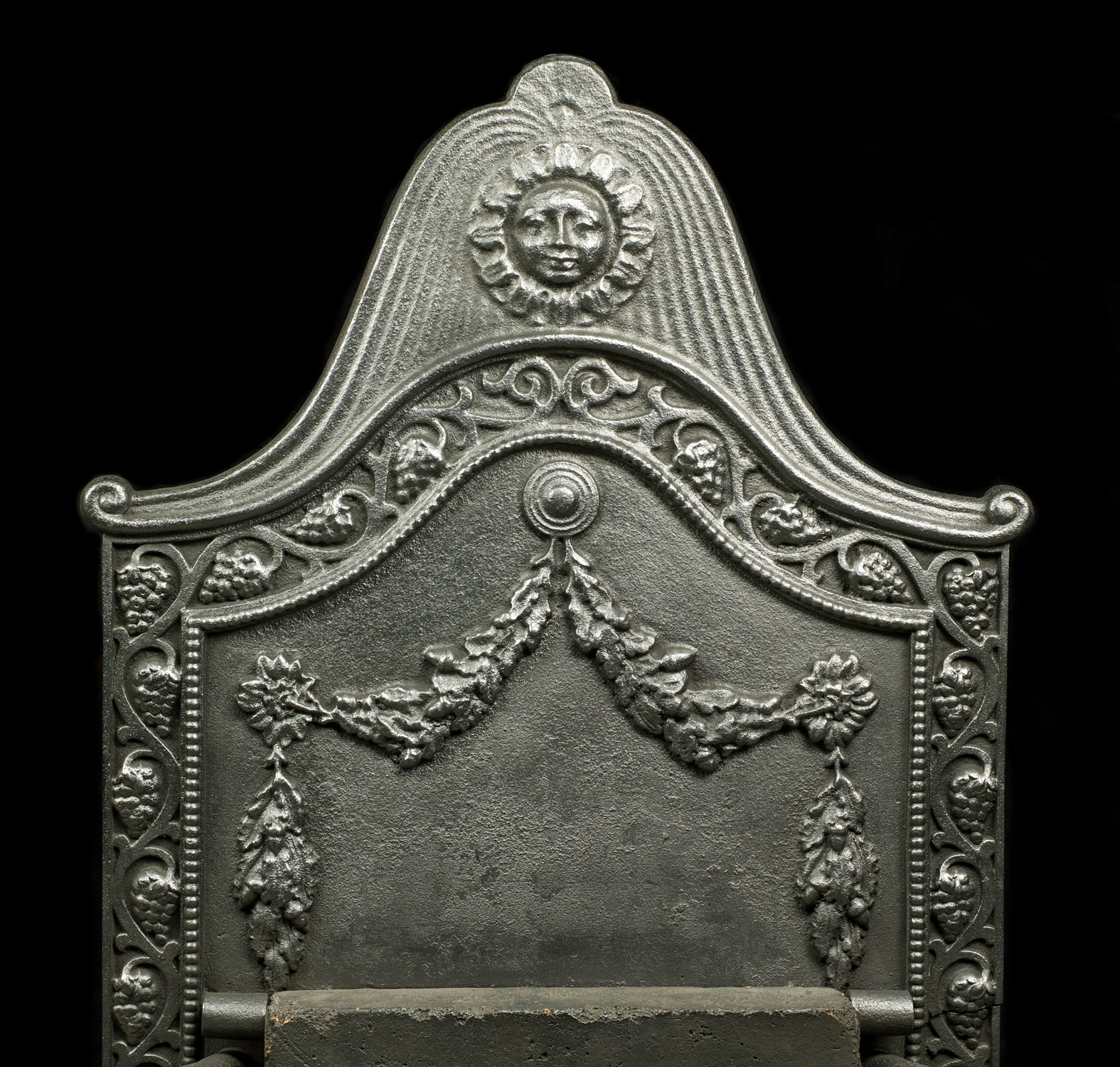 A large 19th century antique iron and brass firegrate