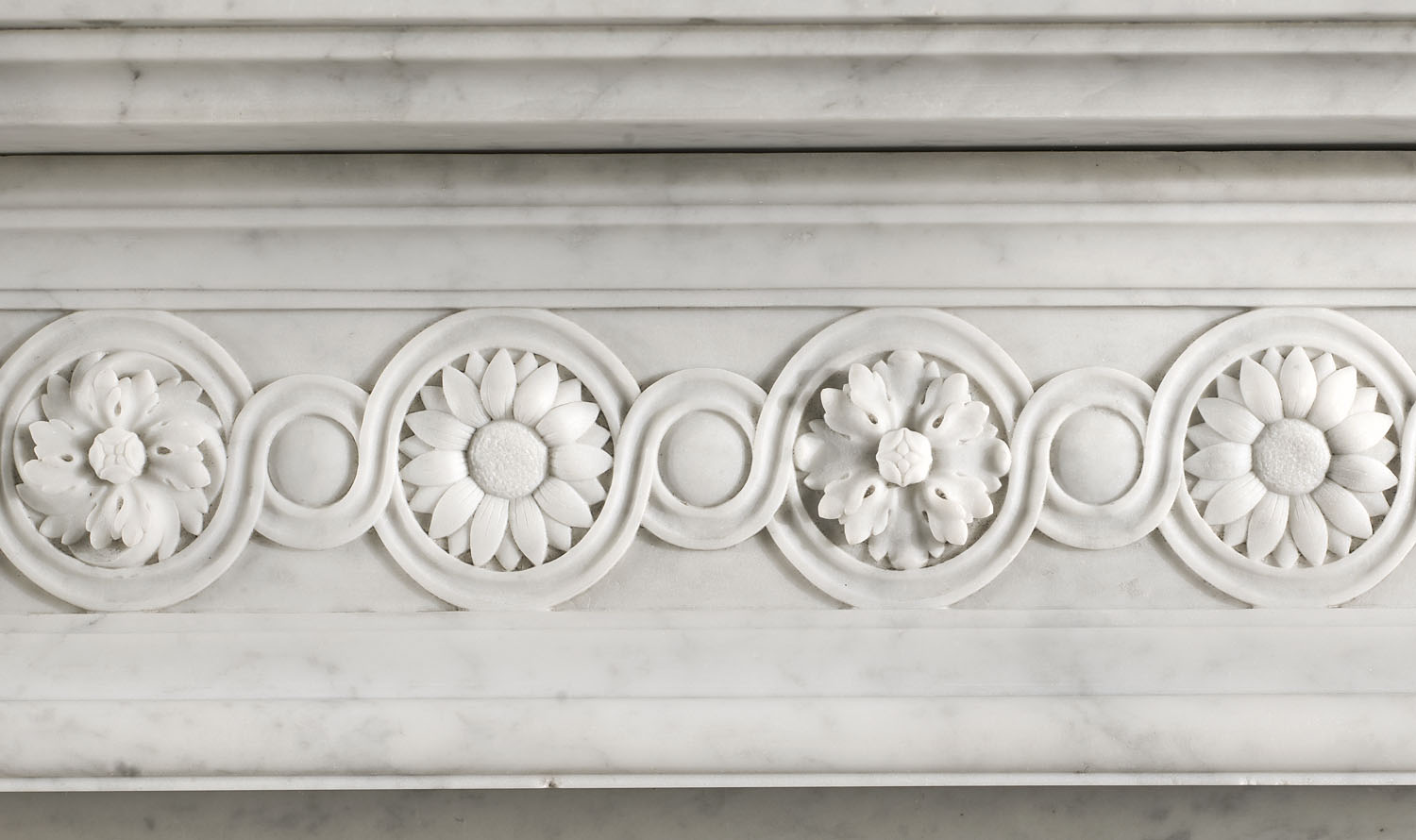 An antique Louis XVI Carrara Marble chimneypiece