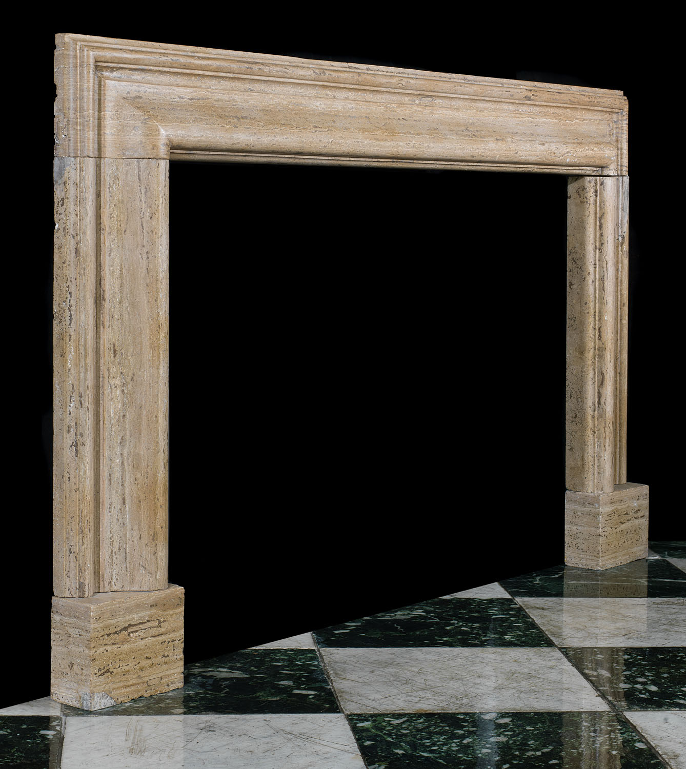 A 20th century Bolection Fireplace Surround in Travertine marble