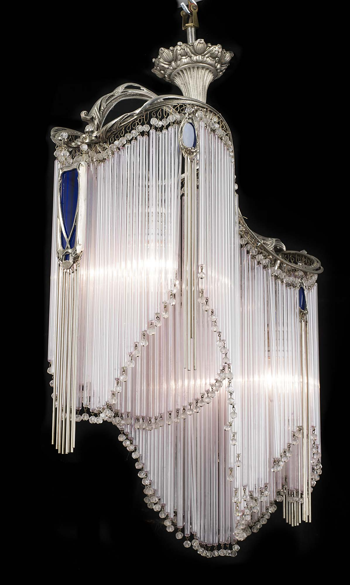 An Art Nouveau style glass and nickel plated ceiling light