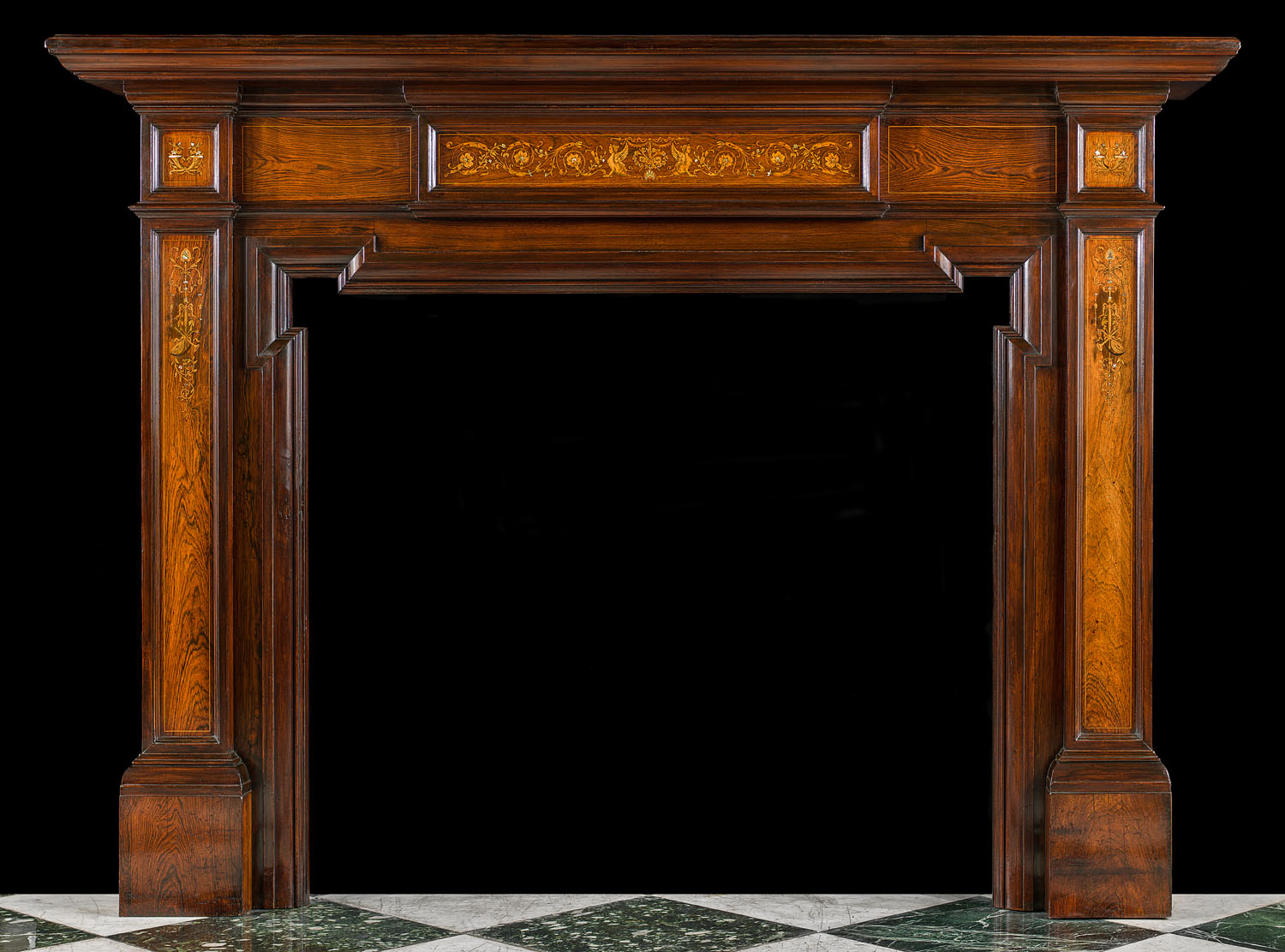 An antique Rosewood Edwardian fireplace surround