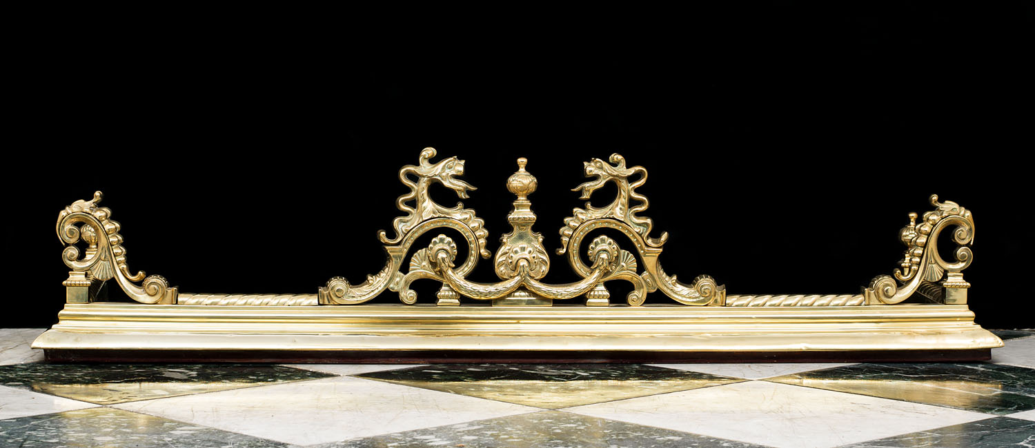 A 19th century Rococo style brass fireplace fender