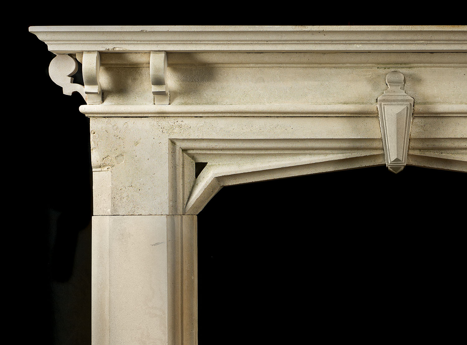 A carved limestone Gothic Revival, Victorian antique chimneypiece