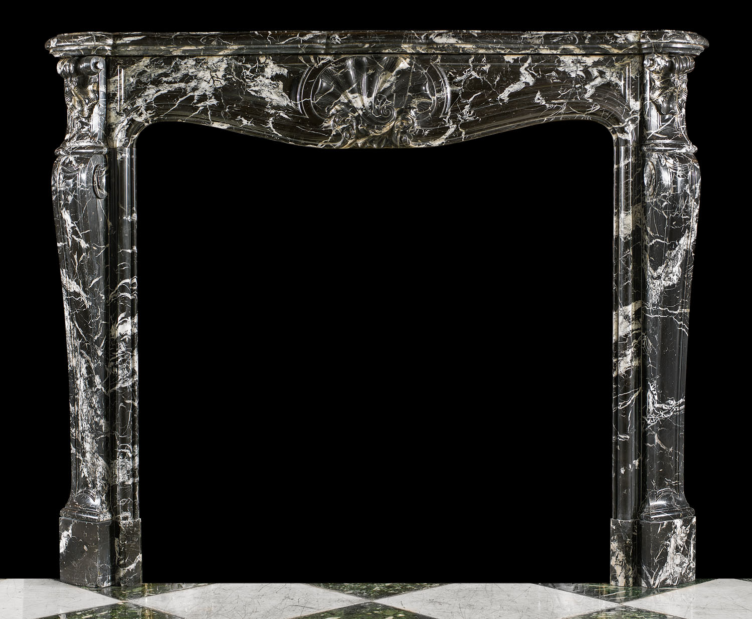 A tall and elegant French Louis XV style Rococo antique chimneypiece.