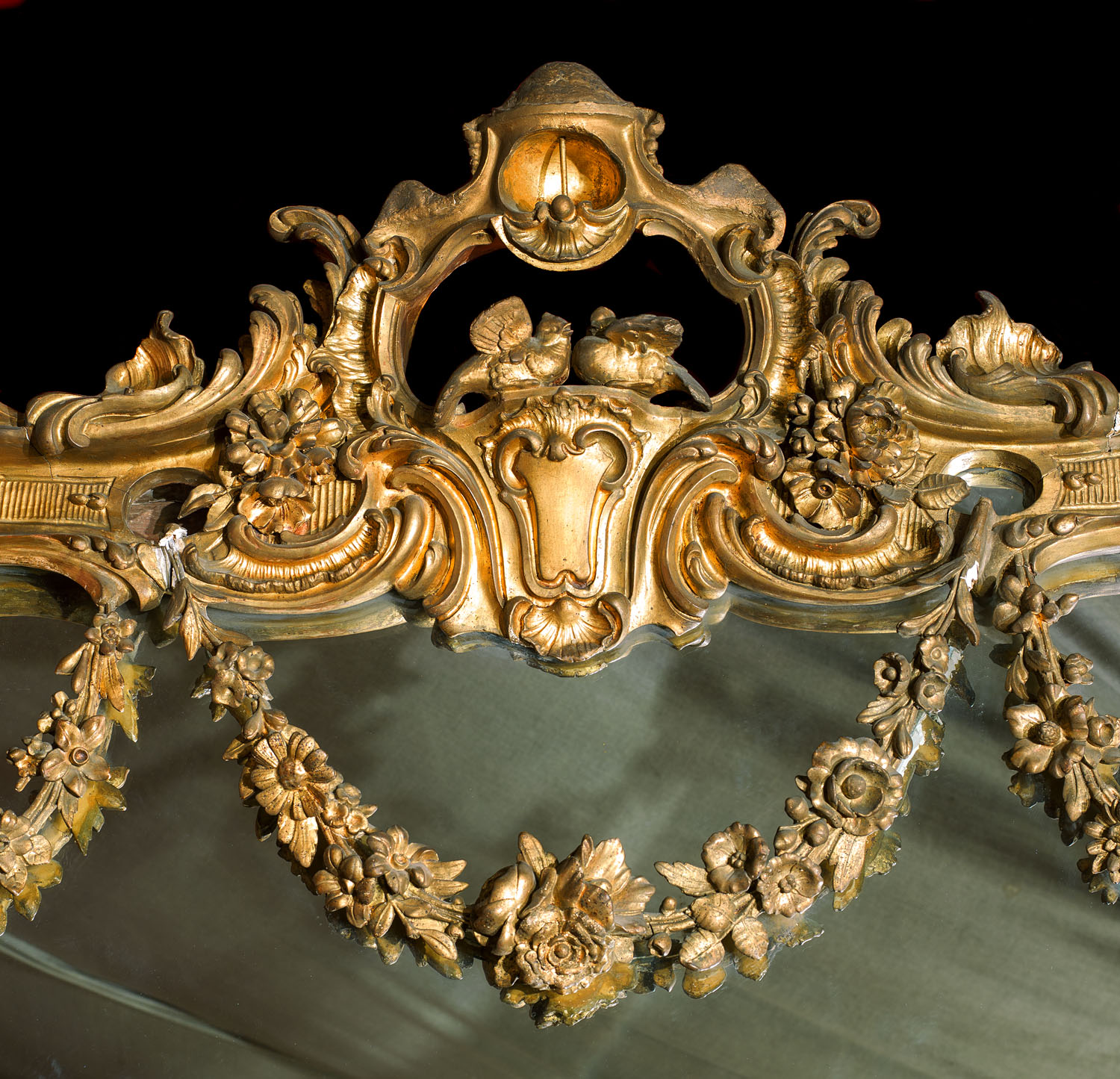 Highly ornate and large Louis XV style giltwood over mantel mirror