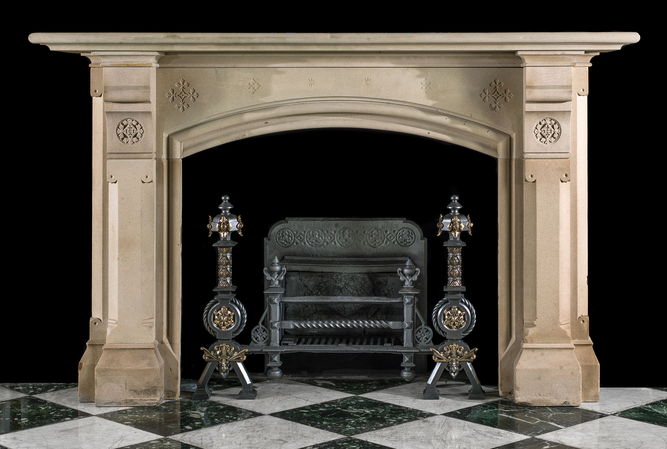 A large Yorkstone Gothic style antique fireplace