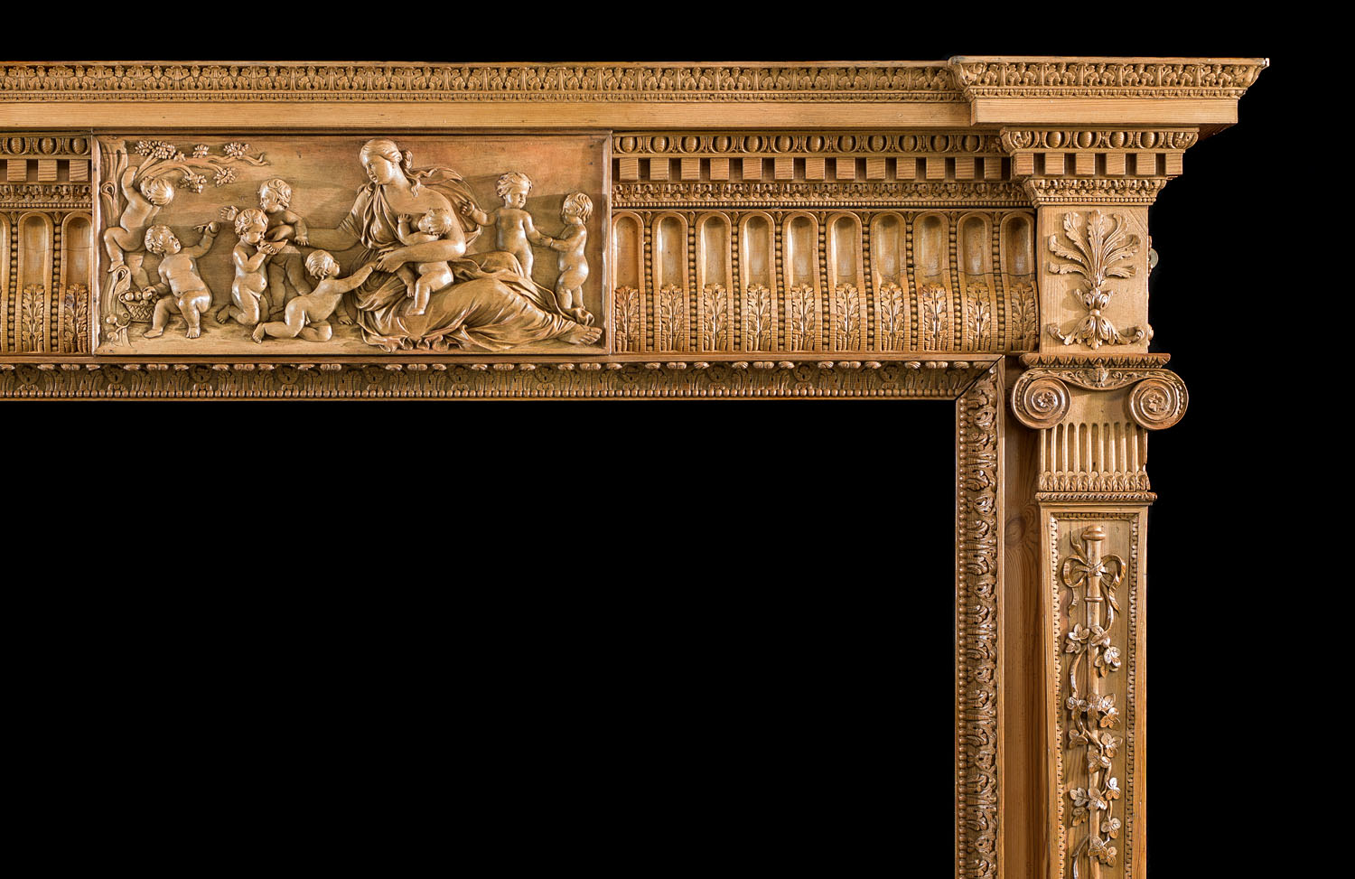 Elaborately carved antique pine fireplace surround