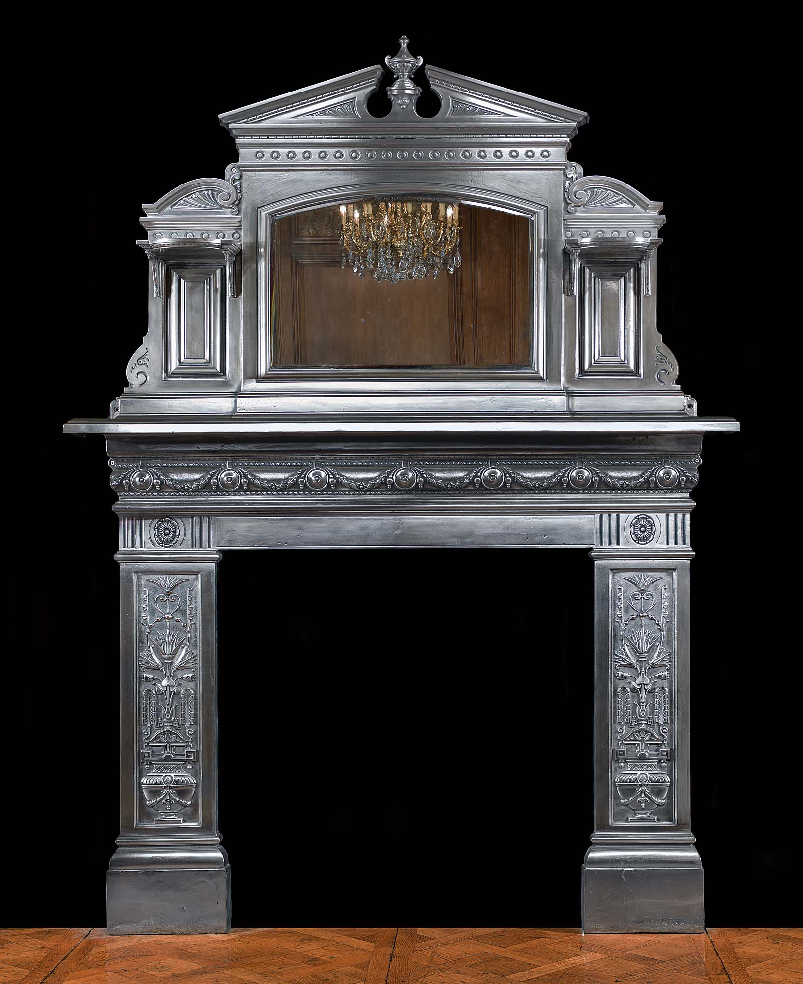 An imposing and tall Victorian cast iron fireplace surround and overmantel