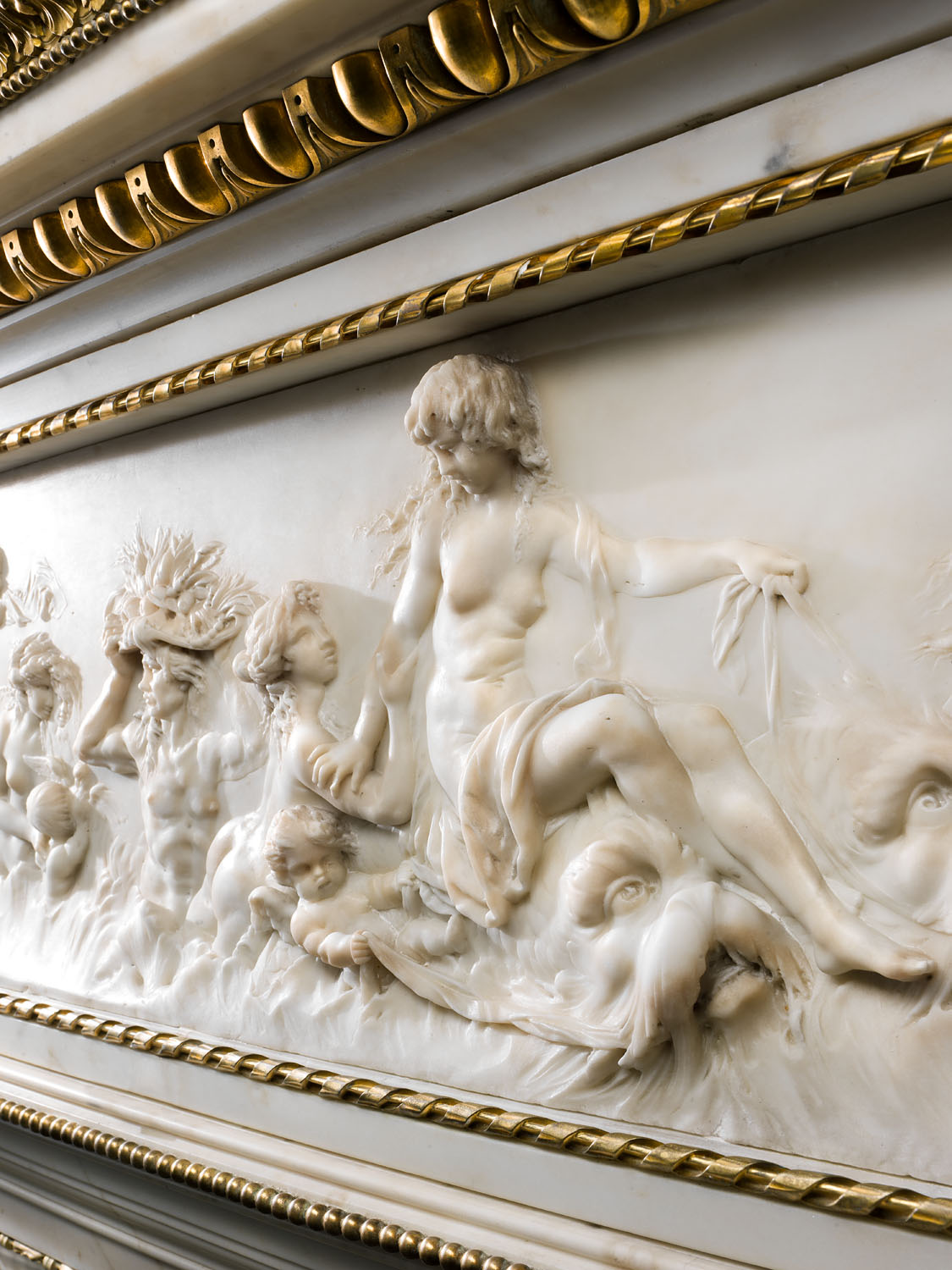 A large antique Statuary Marble French Regency style fireplace surround