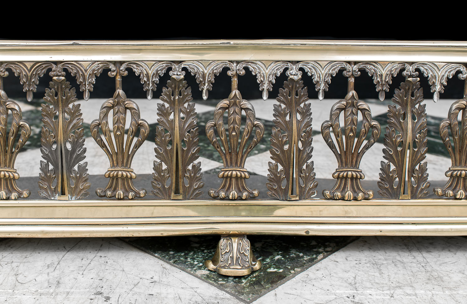 An ornate Regency fireplace fender linked to Warwick Castle