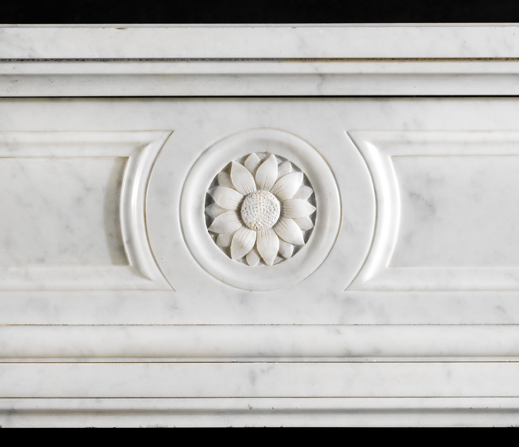 A Louis XVI style Carrara Marble fireplace surround