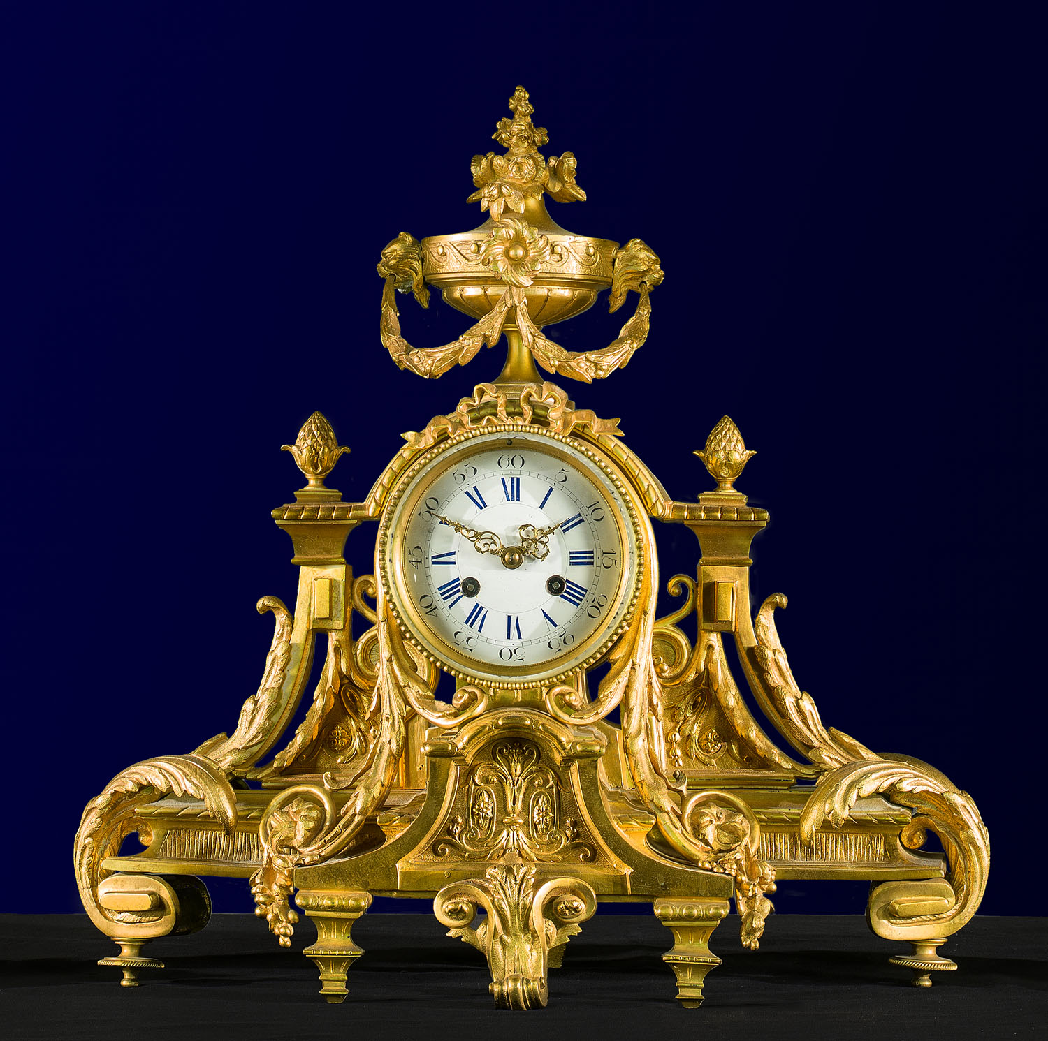 Ornate gilt bronze Rococo style clock garniture