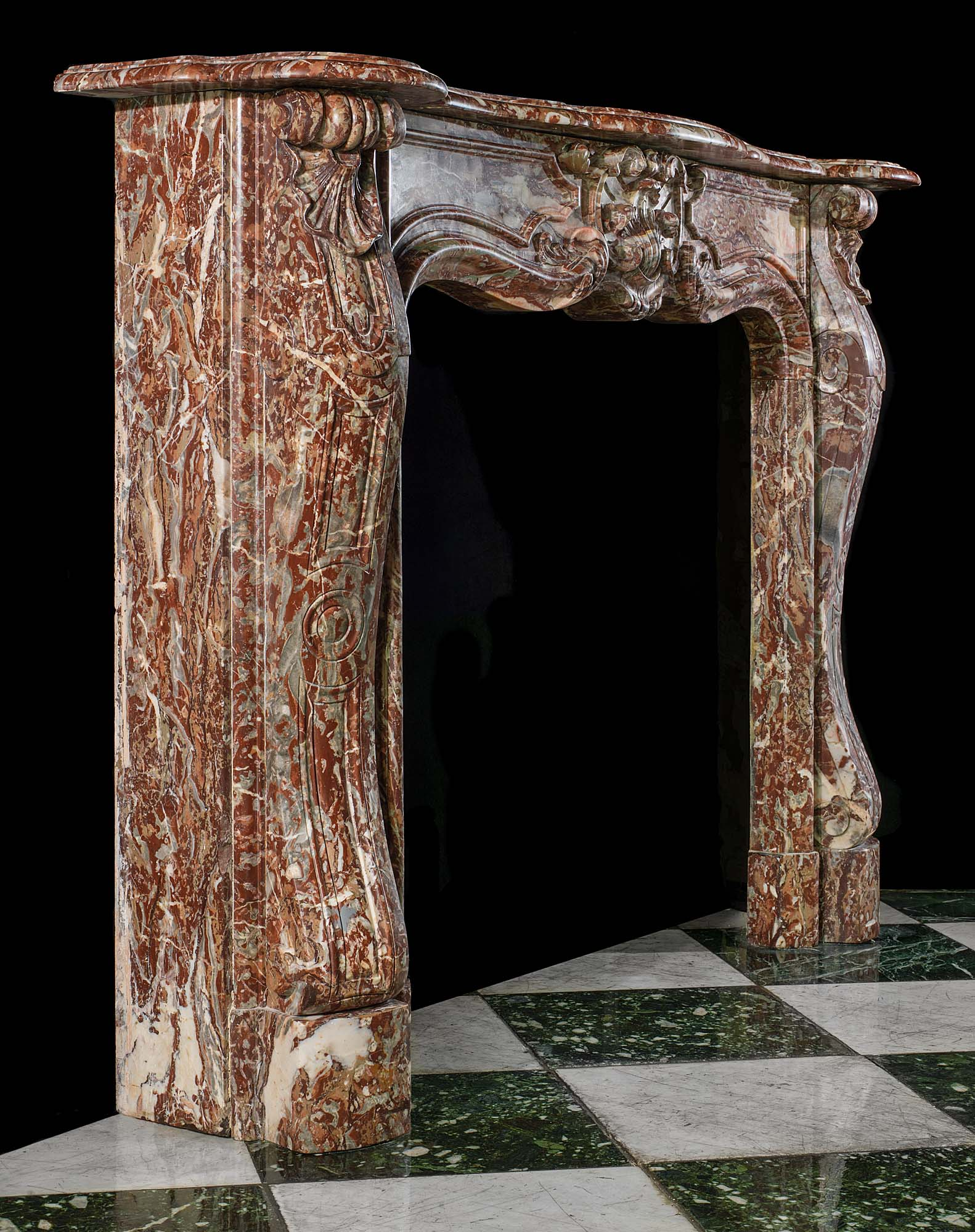 A Rococo style Rouge Royal Marble antique chimneypiece