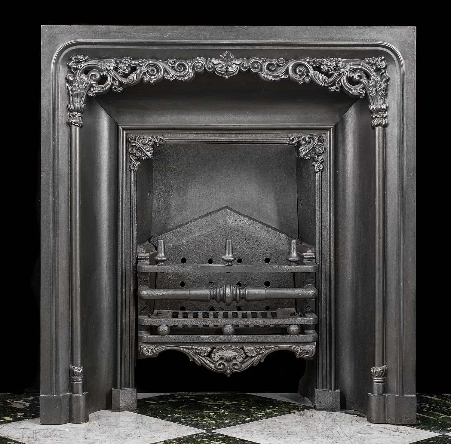 A Georgian cast iron fireplace insert