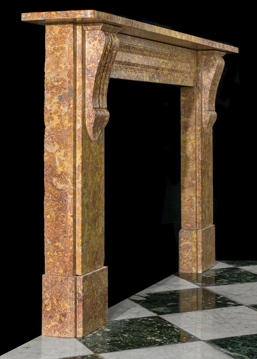 An antique Victorian fireplace mantel in Brocatelle Marble