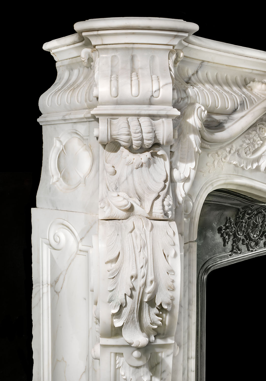 A massive and elaborately carved Rococo Baroque style antique marble chimneypiece