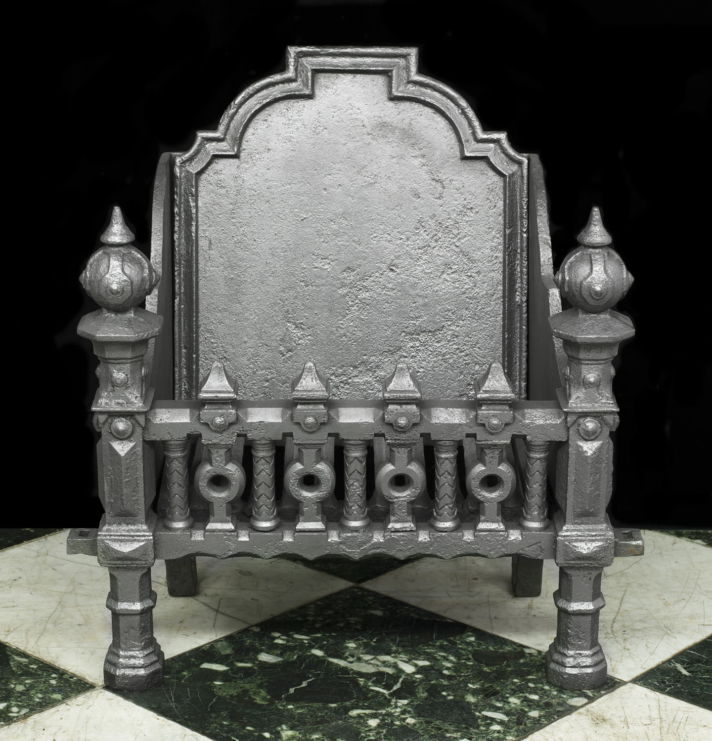 A small French cast iron 18th century Gothic style Fire Grate