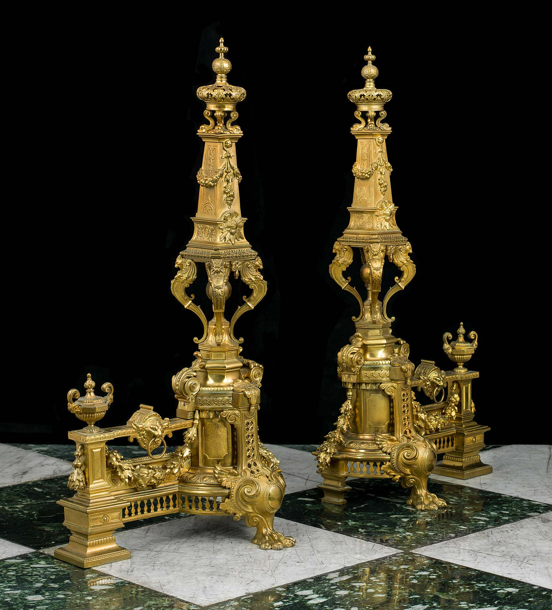 Highly elaborate and tall pair of French gilt brass antique chenet