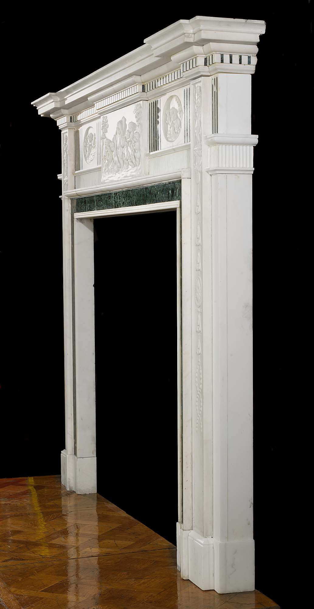 An early 20th century Georgian style inlaid marble antique fireplace surround