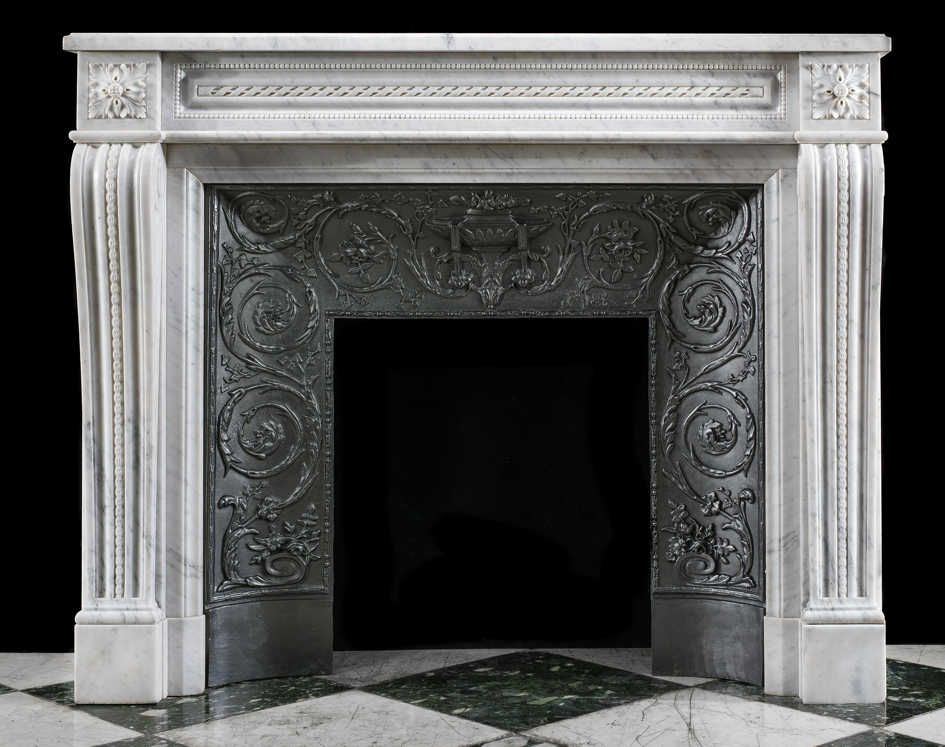 A French Louis XVI style antique marble fireplace and insert.