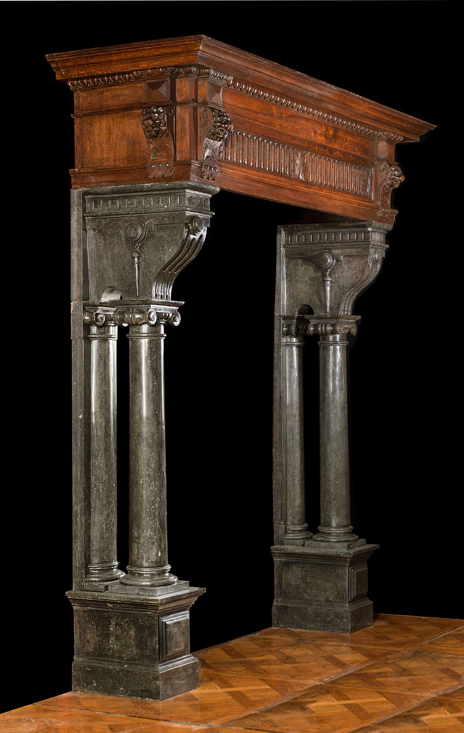 An antique fireplace mantel in Renaissance manner.
