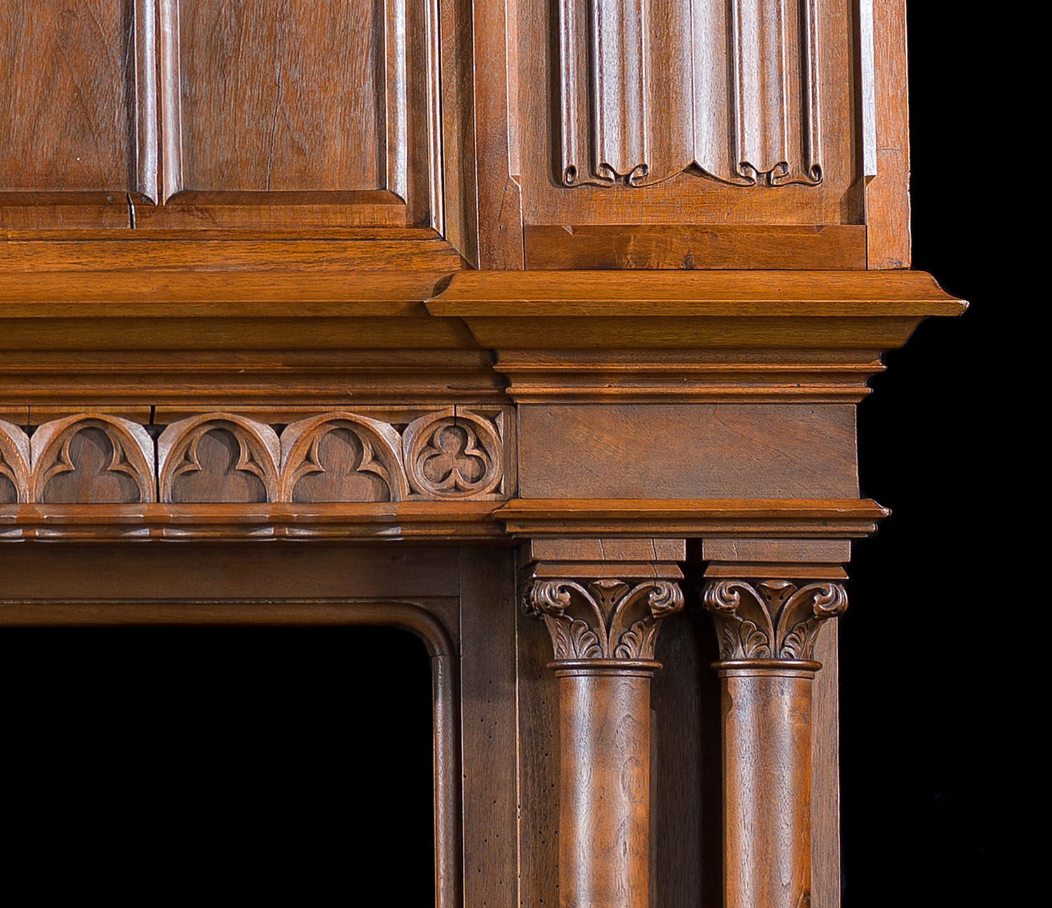 A tall French Trumeau walnut antique fireplace surround