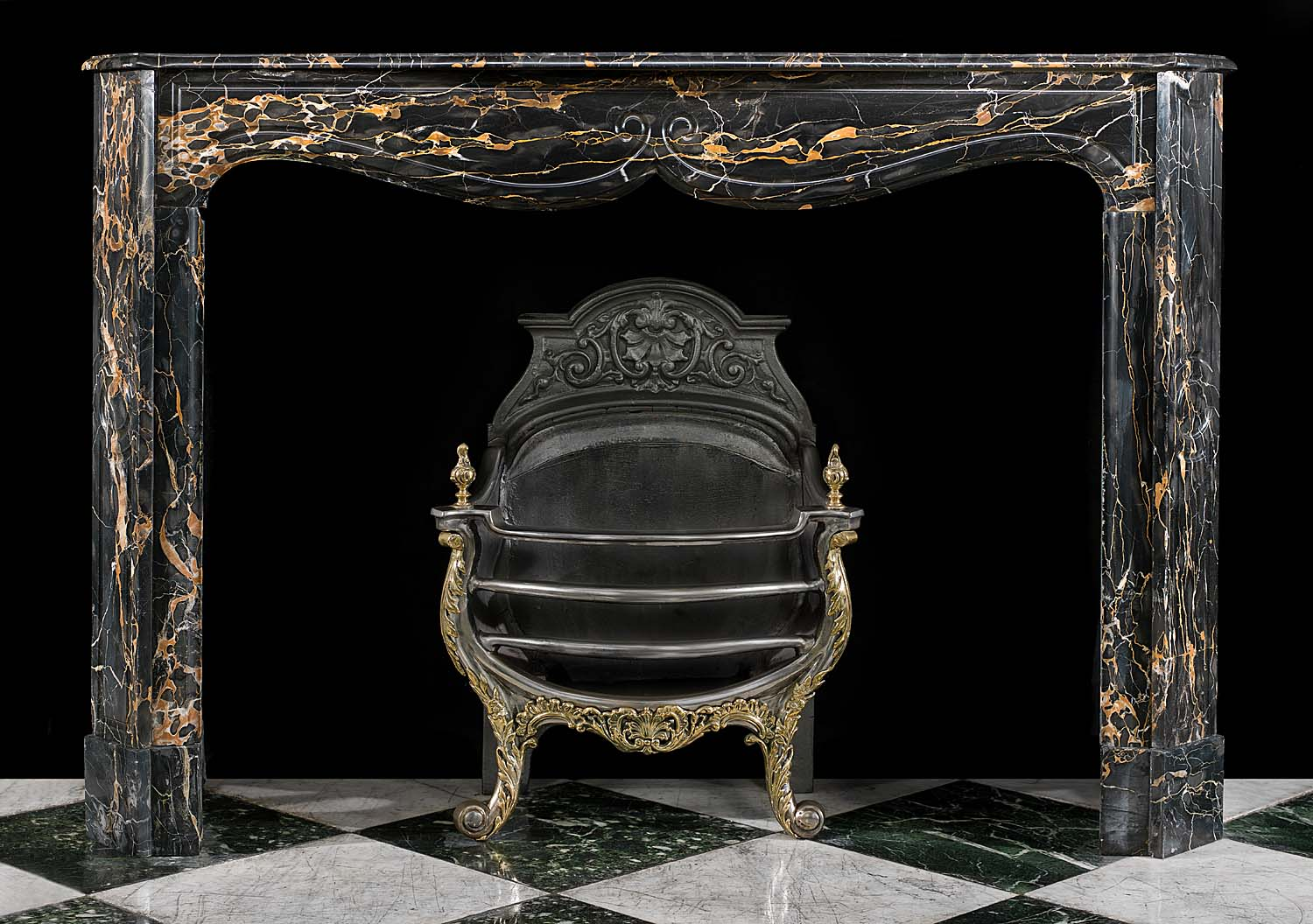 A Louis XV French Rococo style Portoro Marble antique fireplace