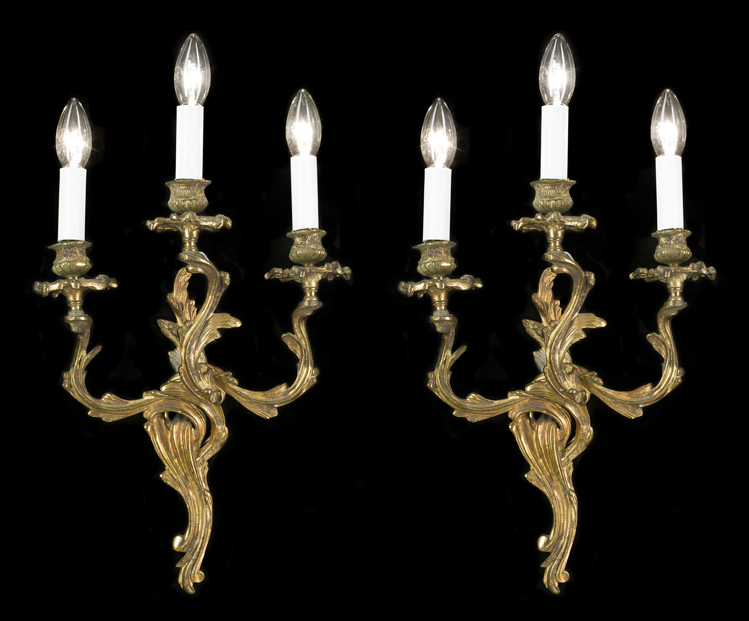 A 20th century pair of Rococo style three branch ormolu wall lights