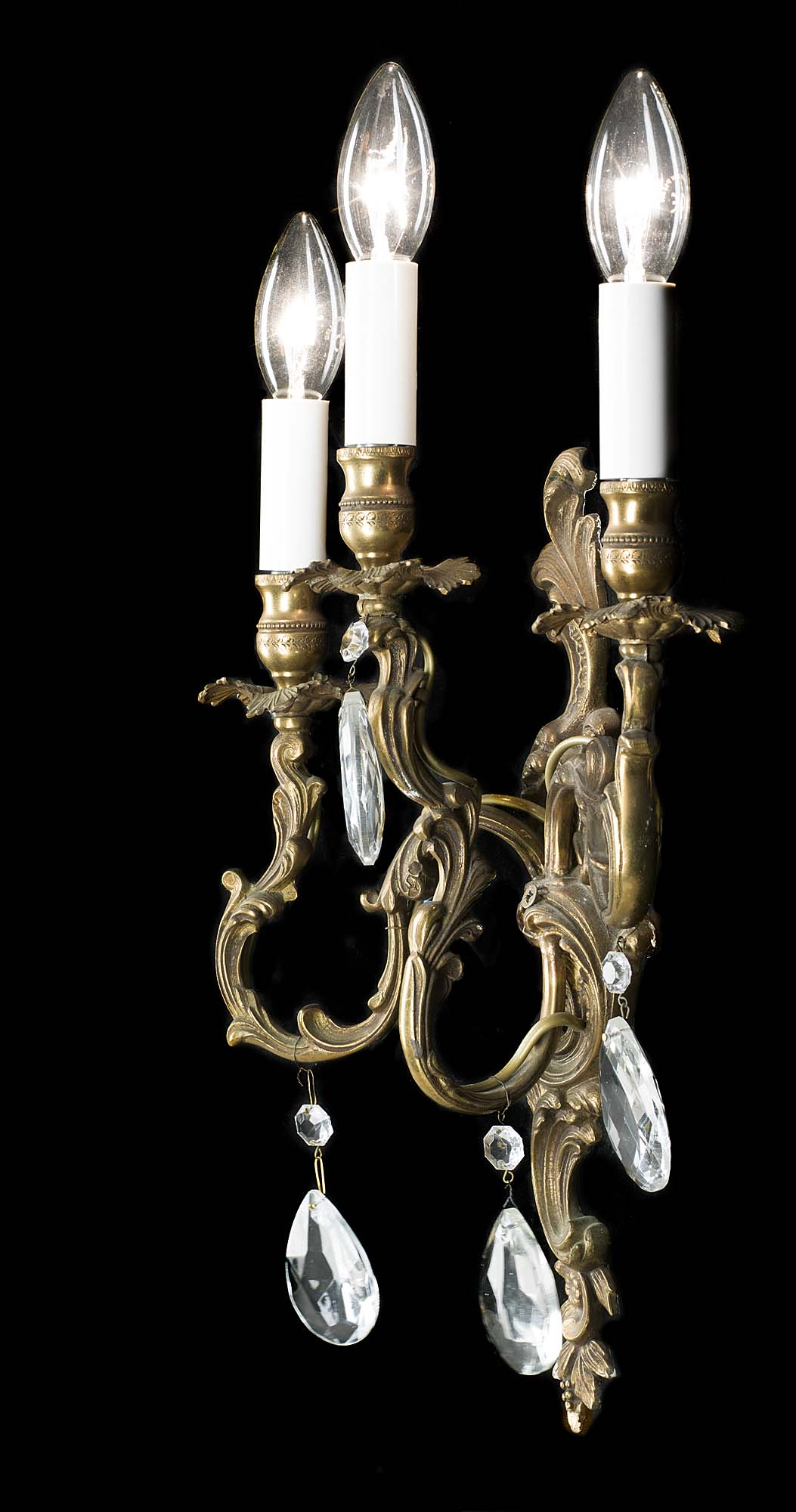 A 20th century set of four gilt brass wall lights