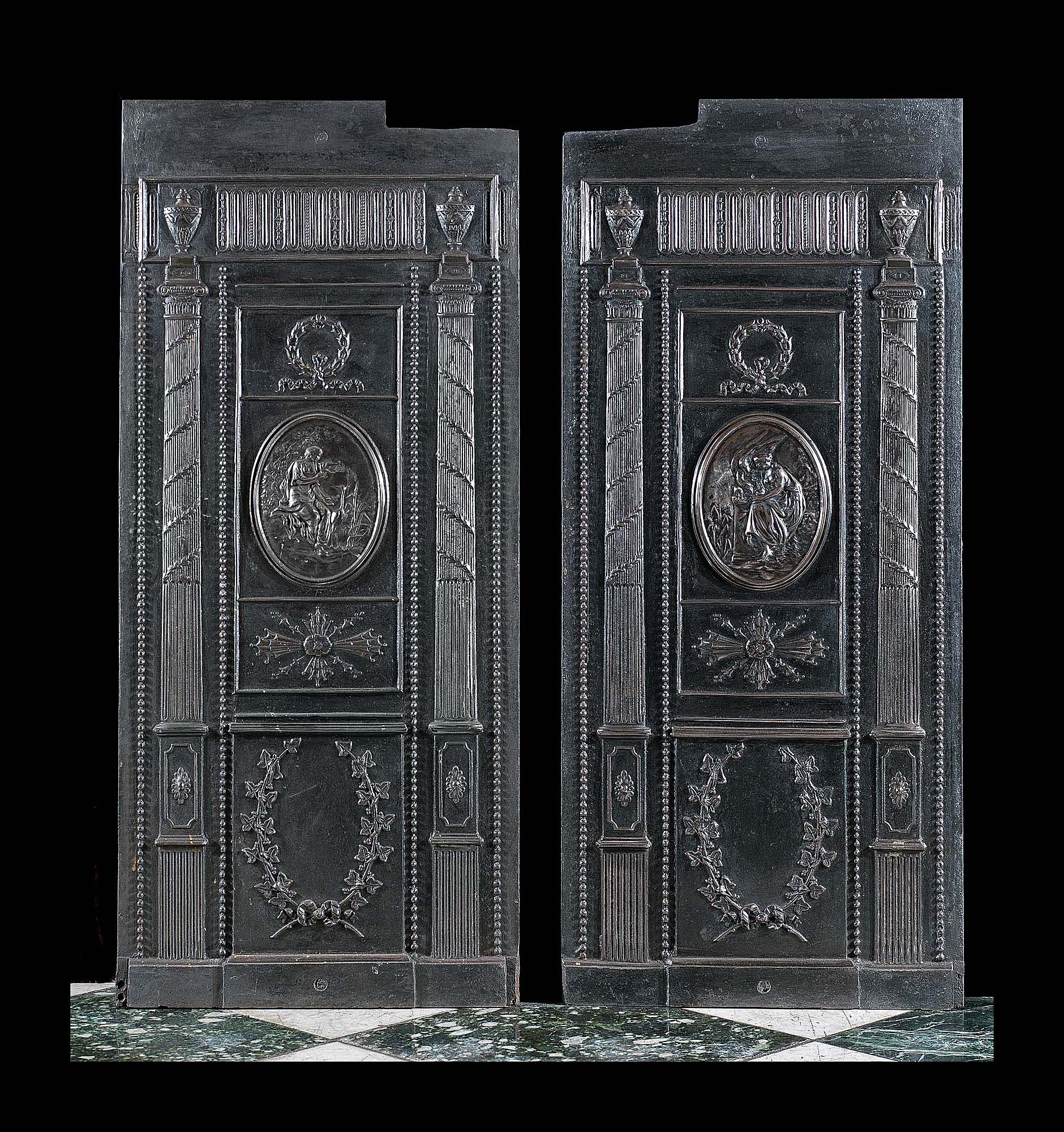 Louis XVI antique pair of large cast iron fireback panels