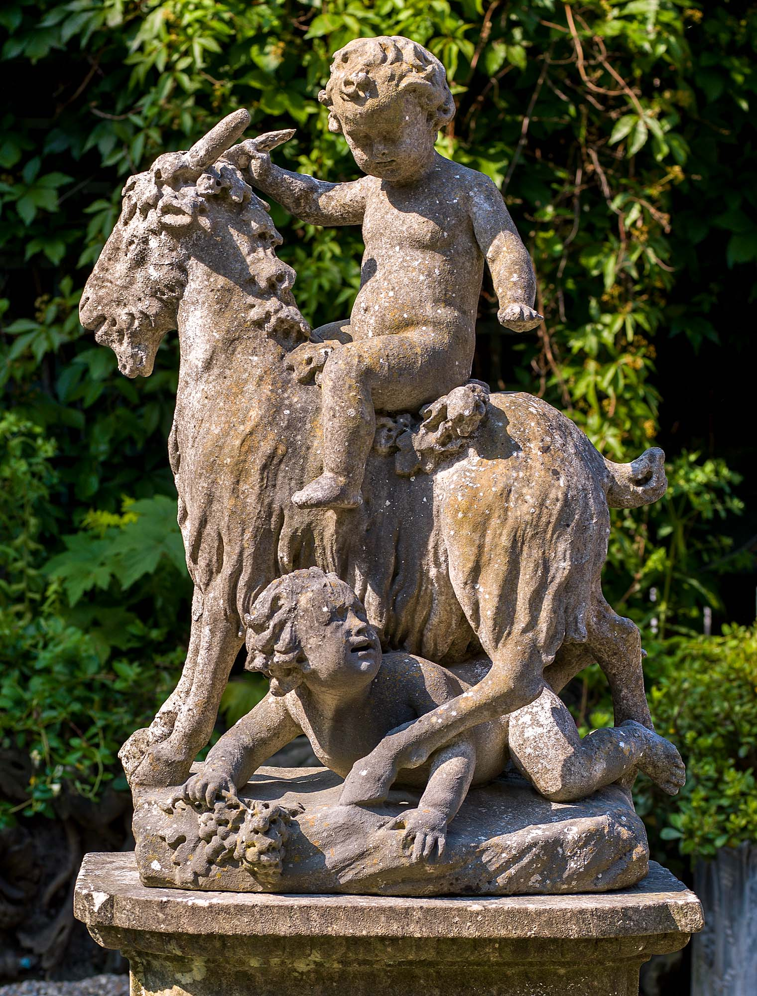 A pair of classical garden sculptures of Putti and Goats in Carrara Marble.