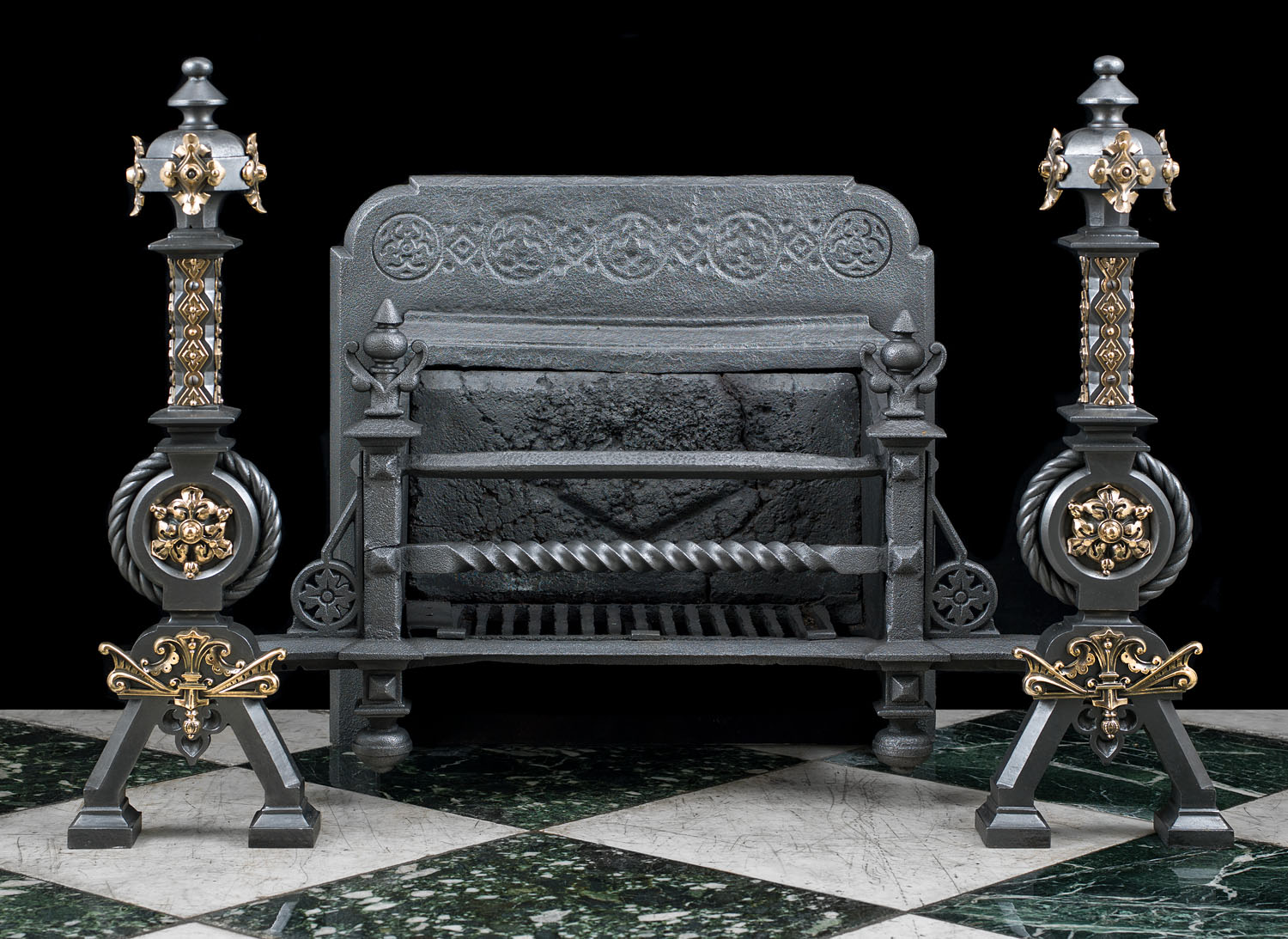 A large Gothic Revival cast iron and parcel gilt antique firegrate