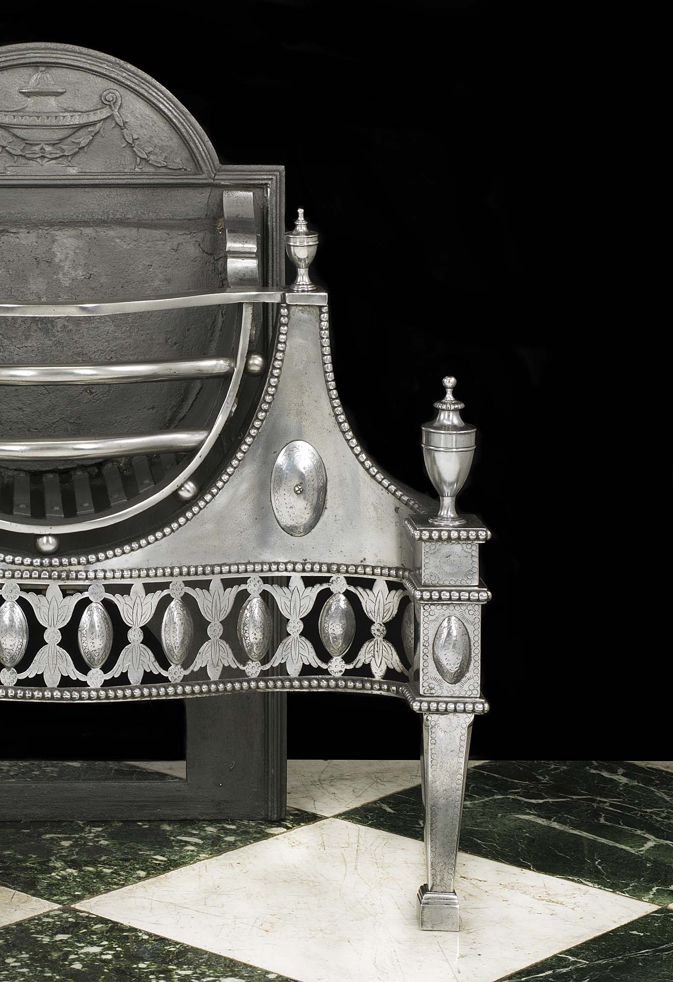 A Georgian style Victorian polished steel antique fire basket