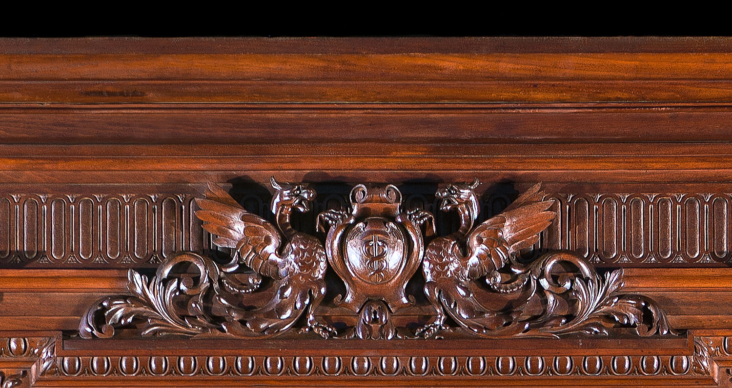 A Renaissance style French walnut fireplace and  overmantel