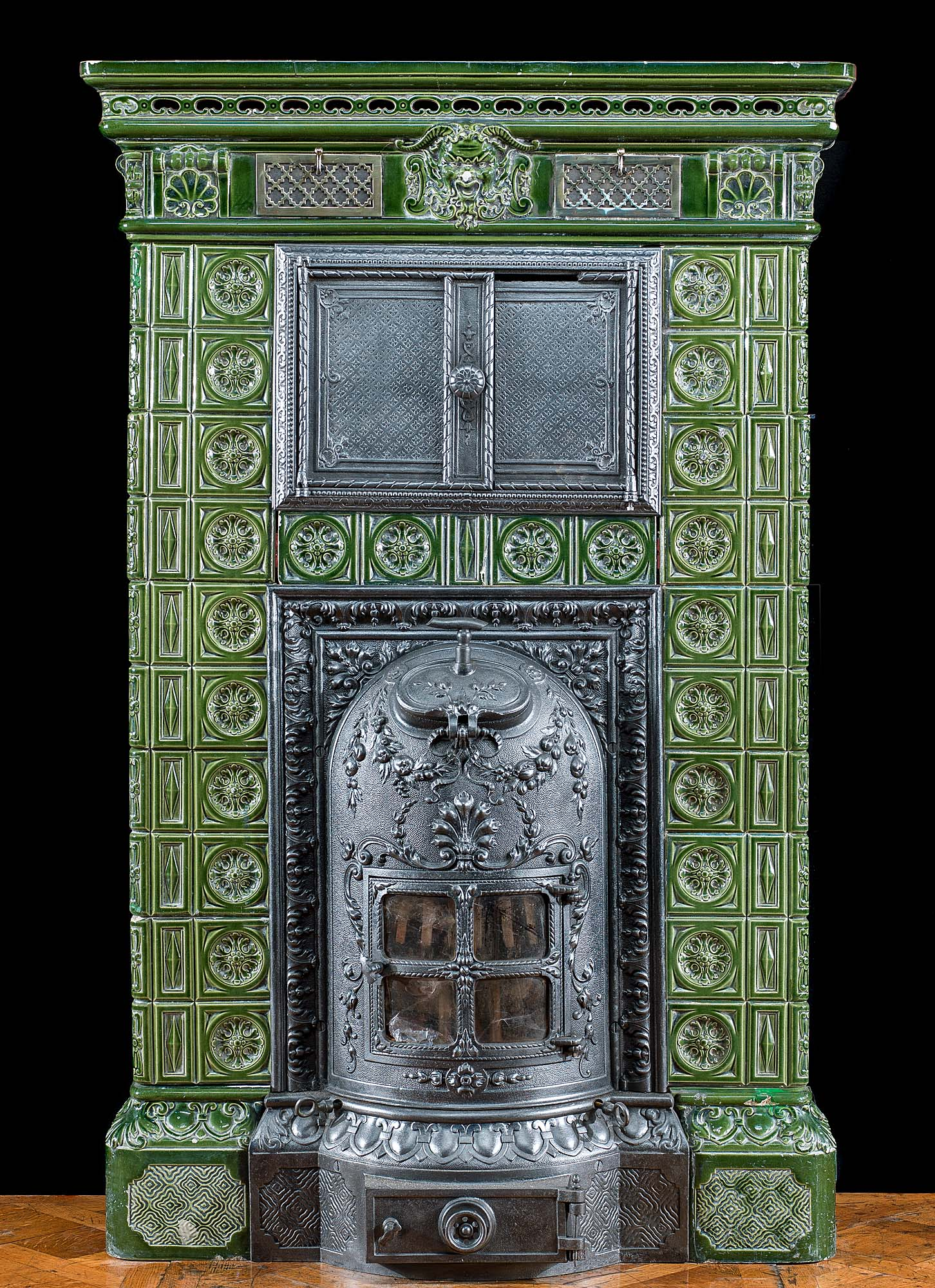 A ceramic French green glazed cast iron stove