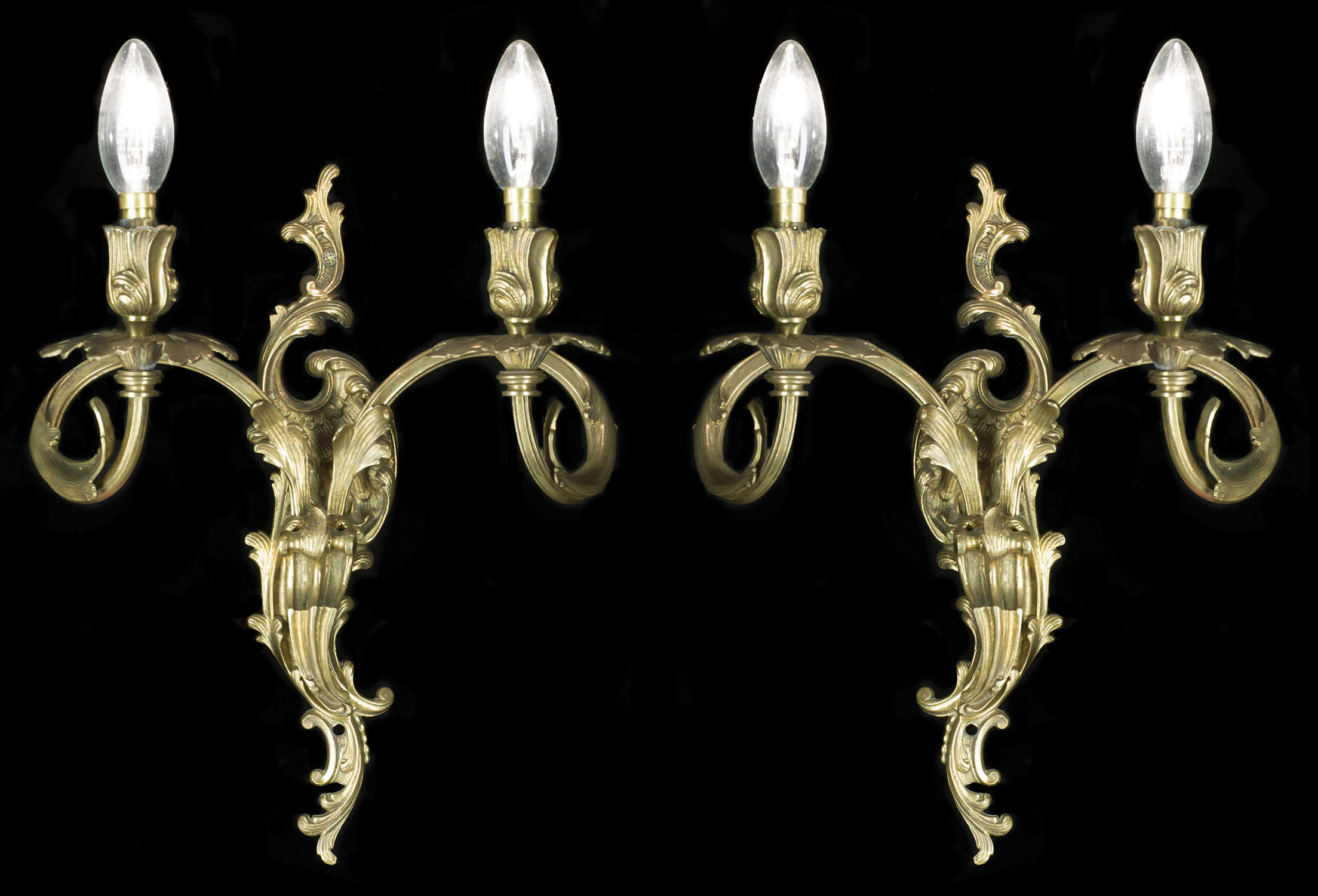 Rococo style set of four antique brass wall lights