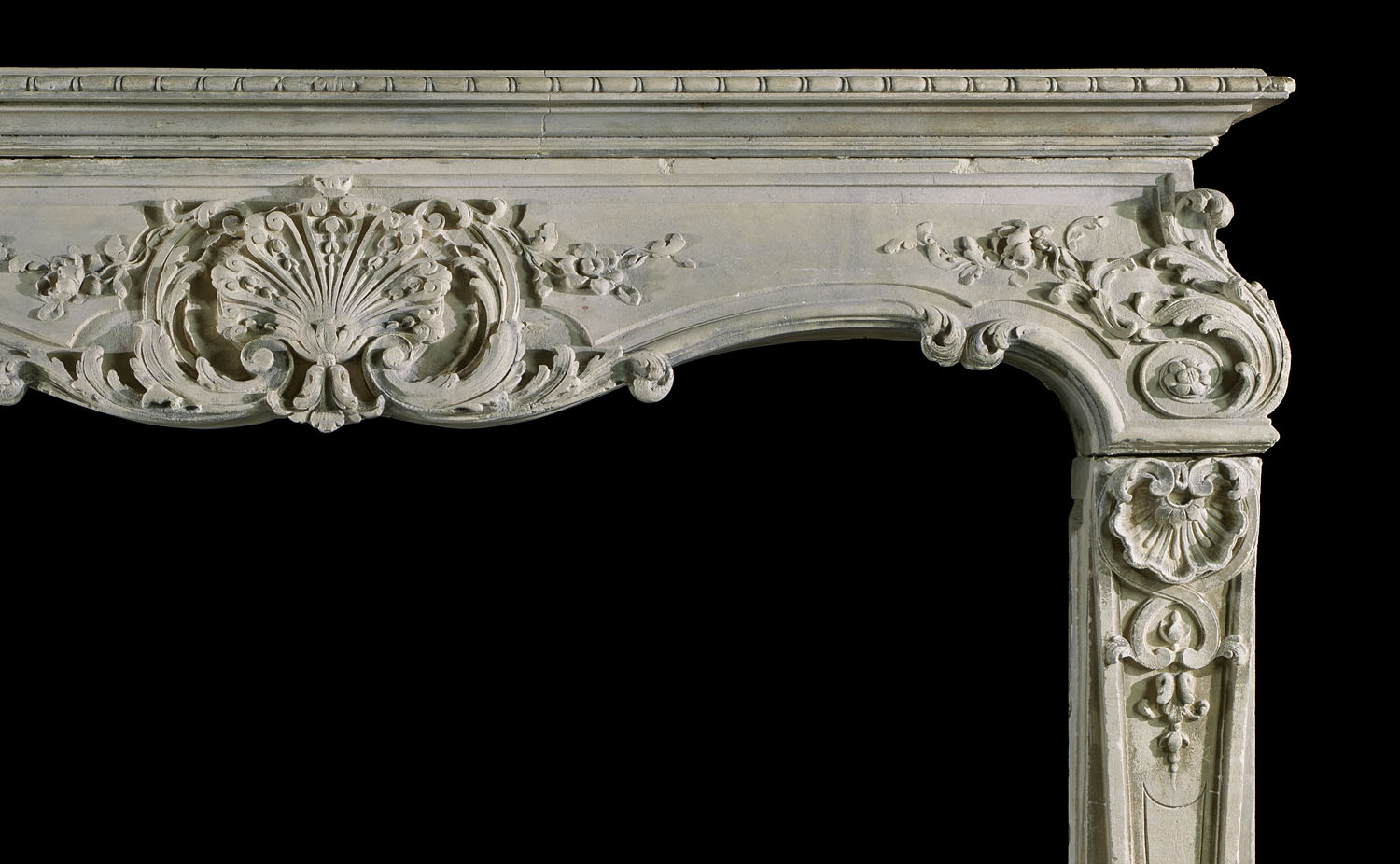 A Louis XV Rococo style antique stone fireplace mantel