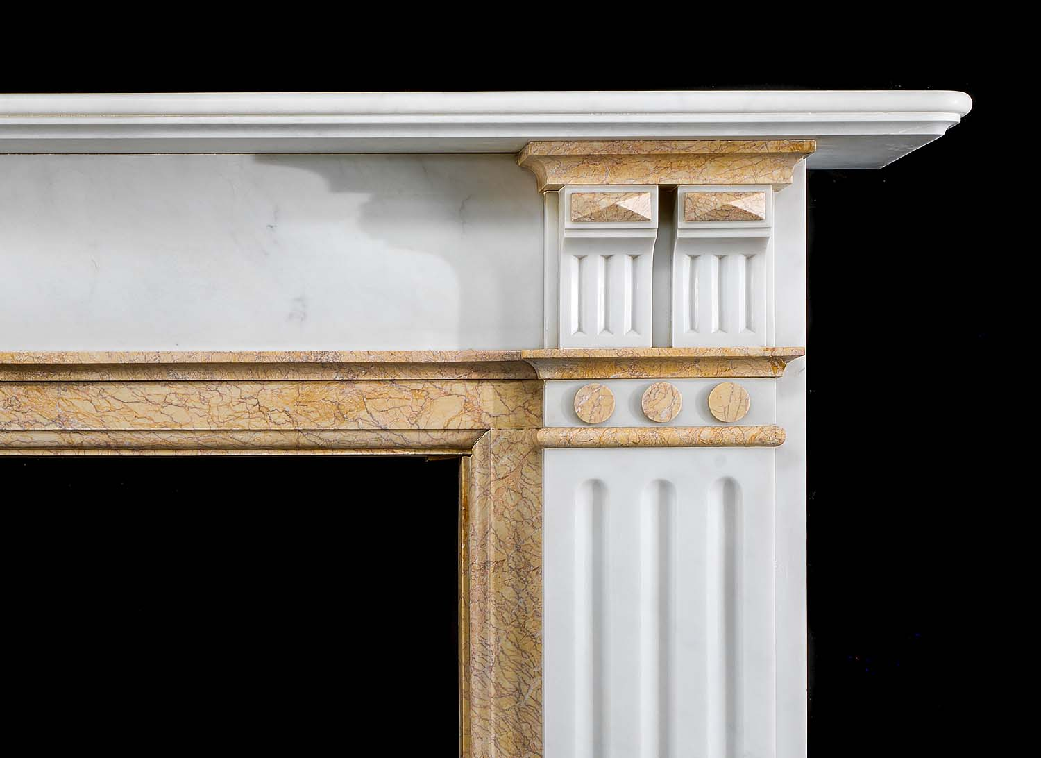 A simple white and Crema Valencia marble antique fireplace.