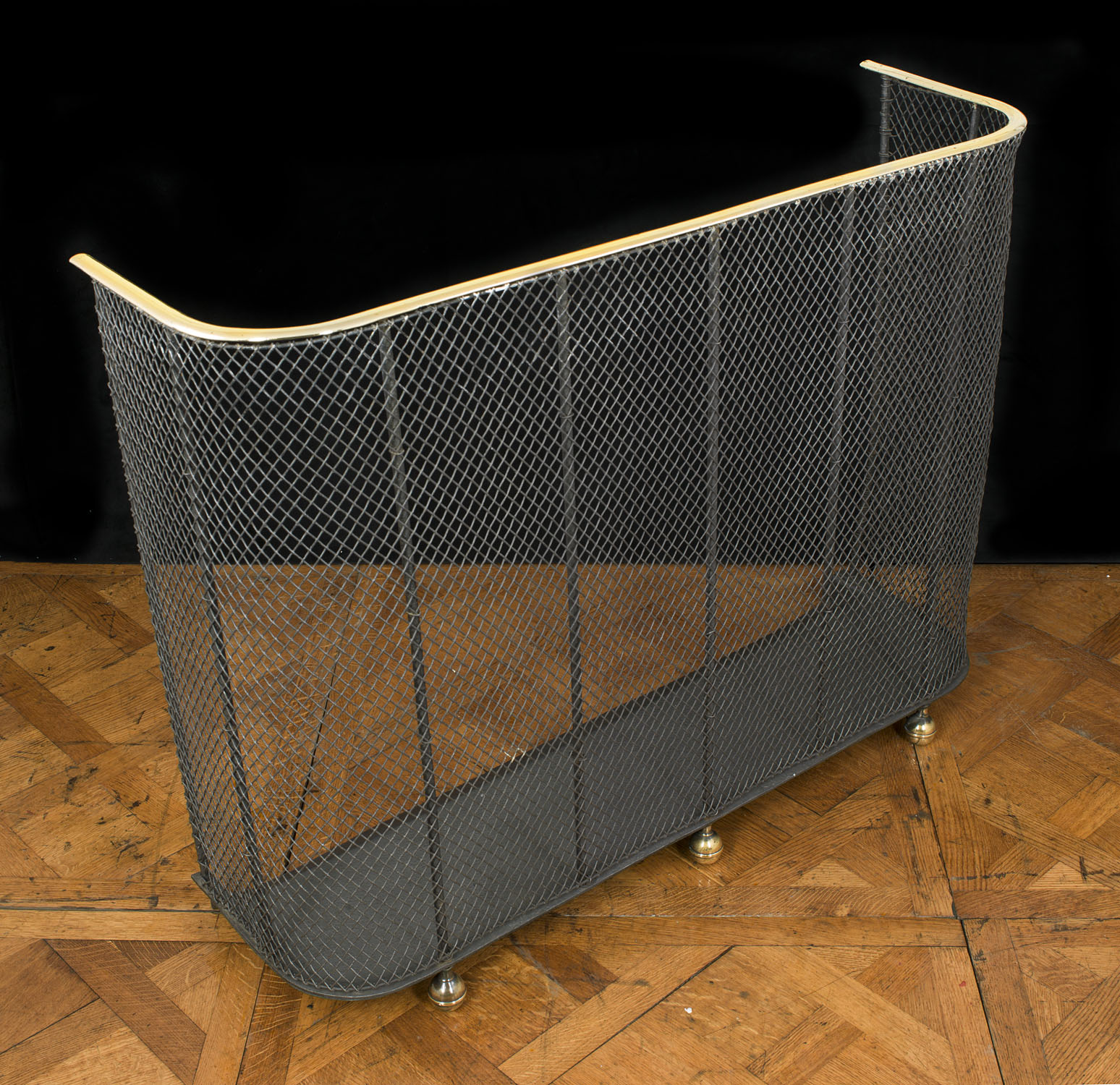 A Traditional Brass and wire mesh Victorian Fire Guard