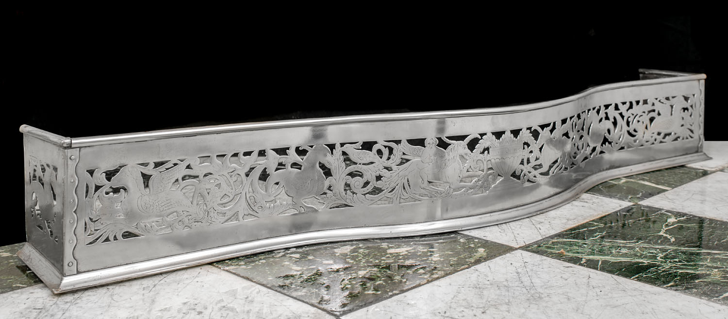 A cut and engraved steel antique Georgian fireplace fender