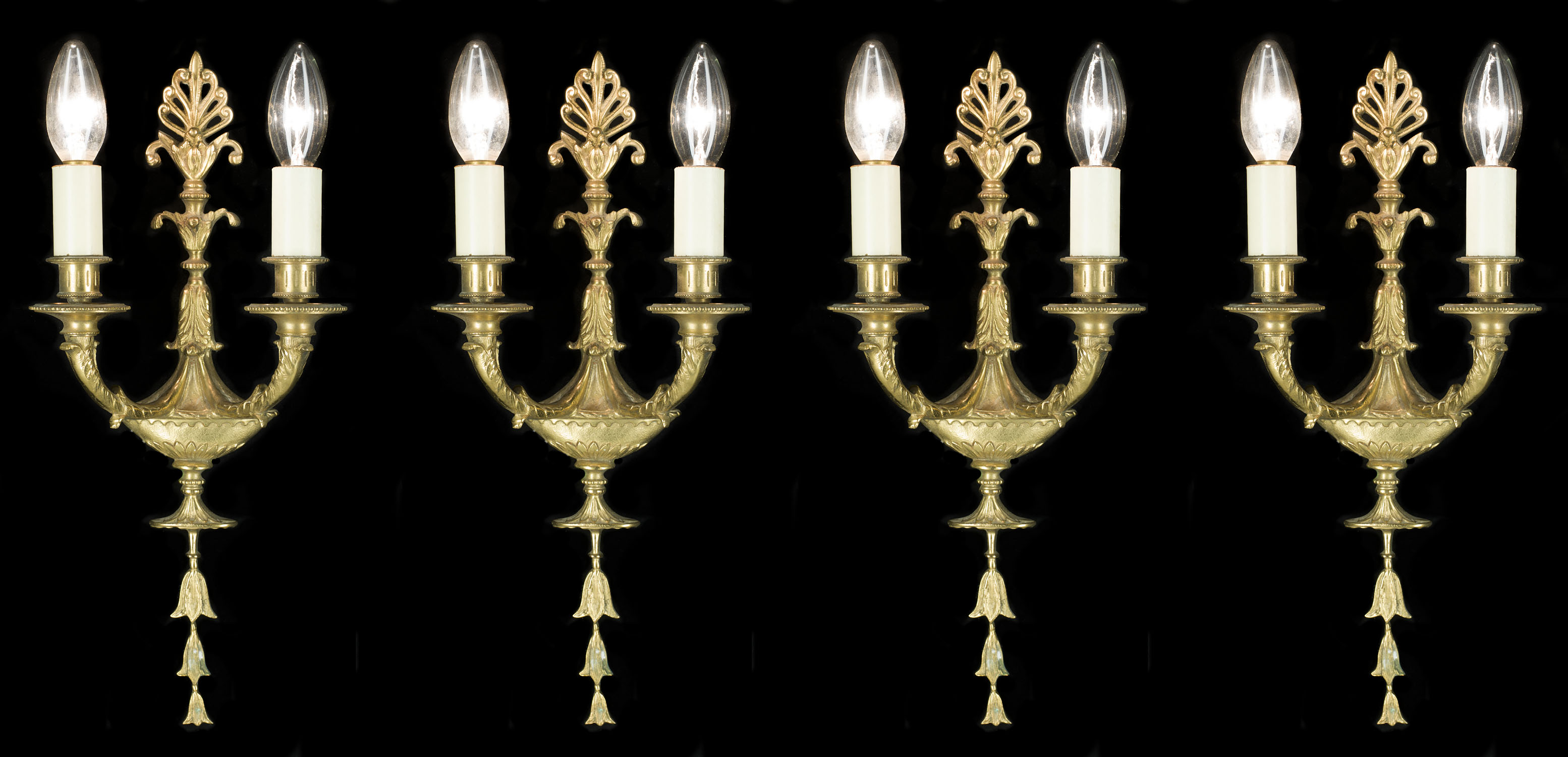 A 20th century set of four Regency style wall lights